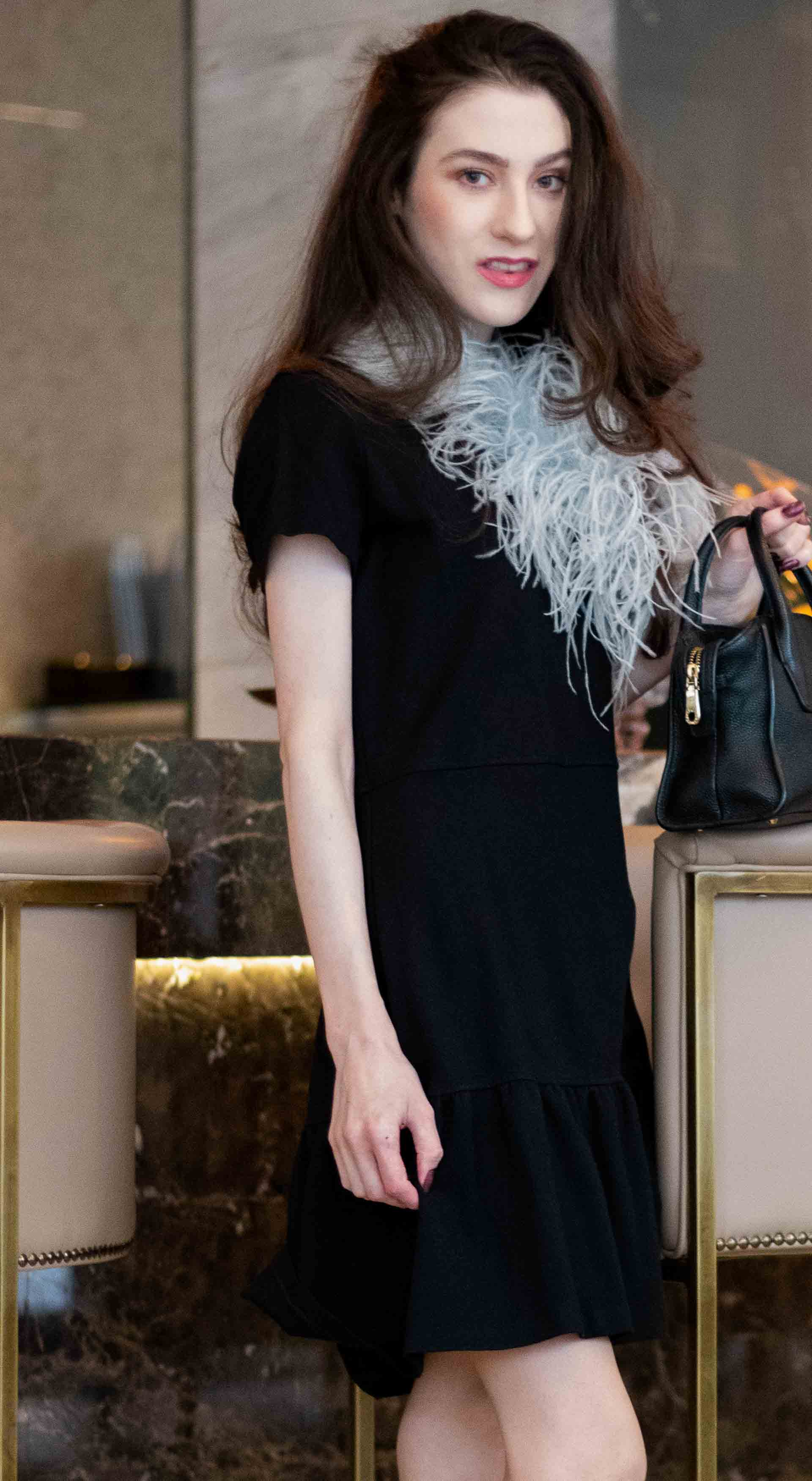 994ce32ed4812 Popular Fashion Blogger Veronika Lipar of Brunette from Wall Street wearing  short sleeve LBD with feathers