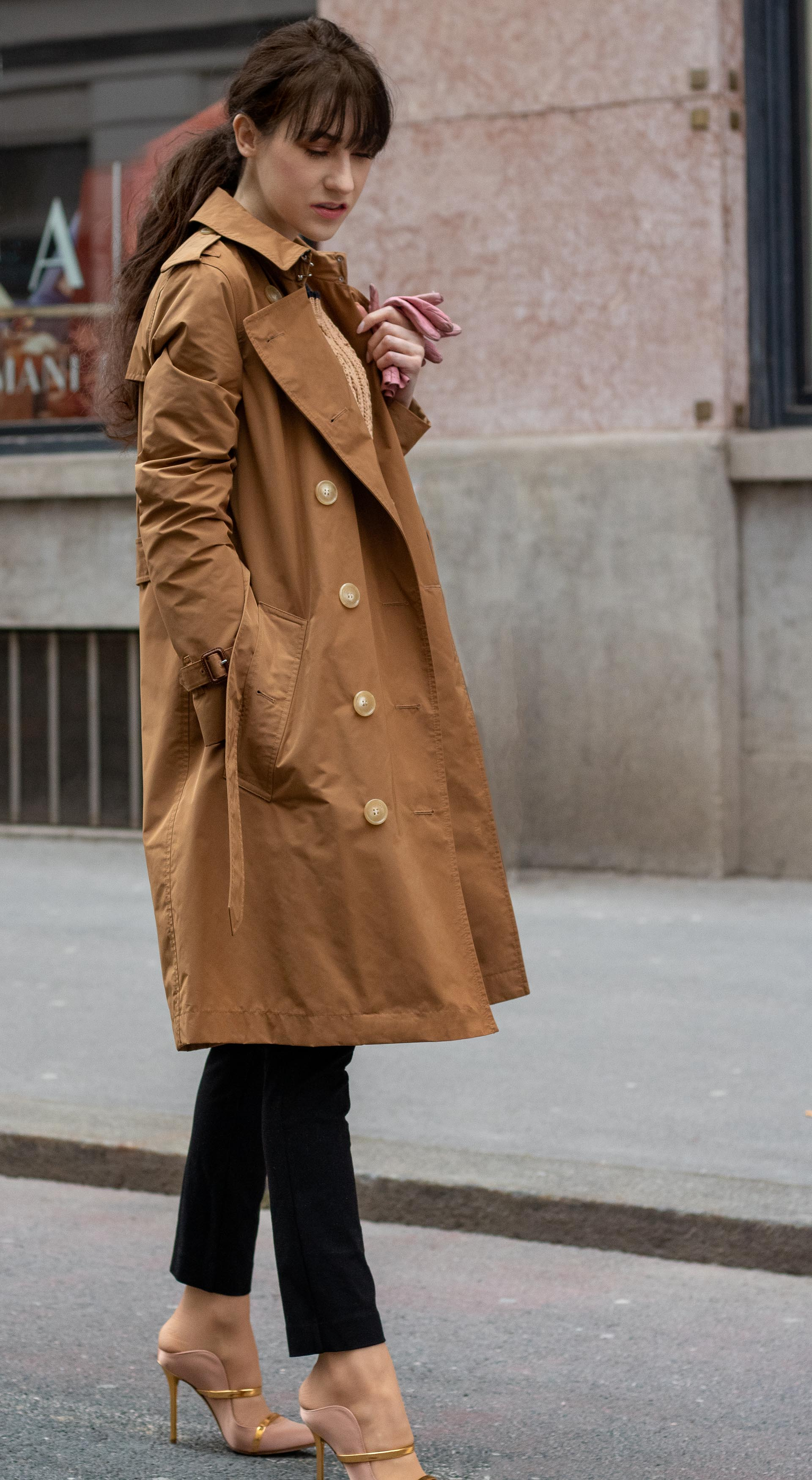 Must follow Slovenian Fashion Blogger Veronika Lipar of Brunette from Wall Street dressed in camel Burberry trench coat Mango cable knit sweater black slacks blush Malone Souliers mules low ponytail bangs going to the office