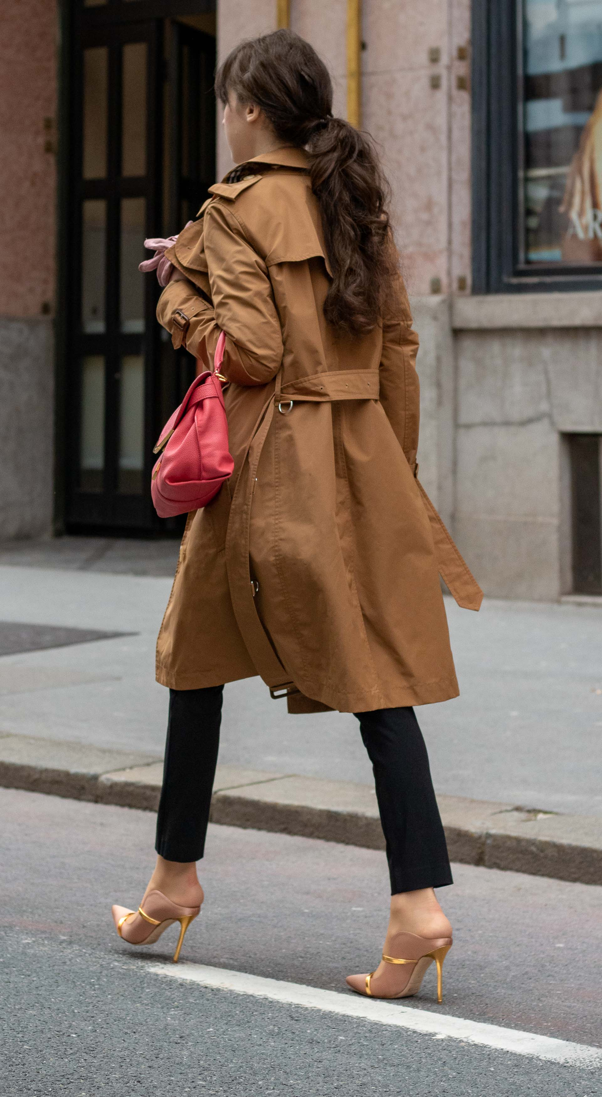 Must follow Slovenian Fashion Blogger Veronika Lipar of Brunette from Wall Street wearing camel Burberry trench coat black slacks blush Malone Souliers mules pink top handle bag low ponytail going to work