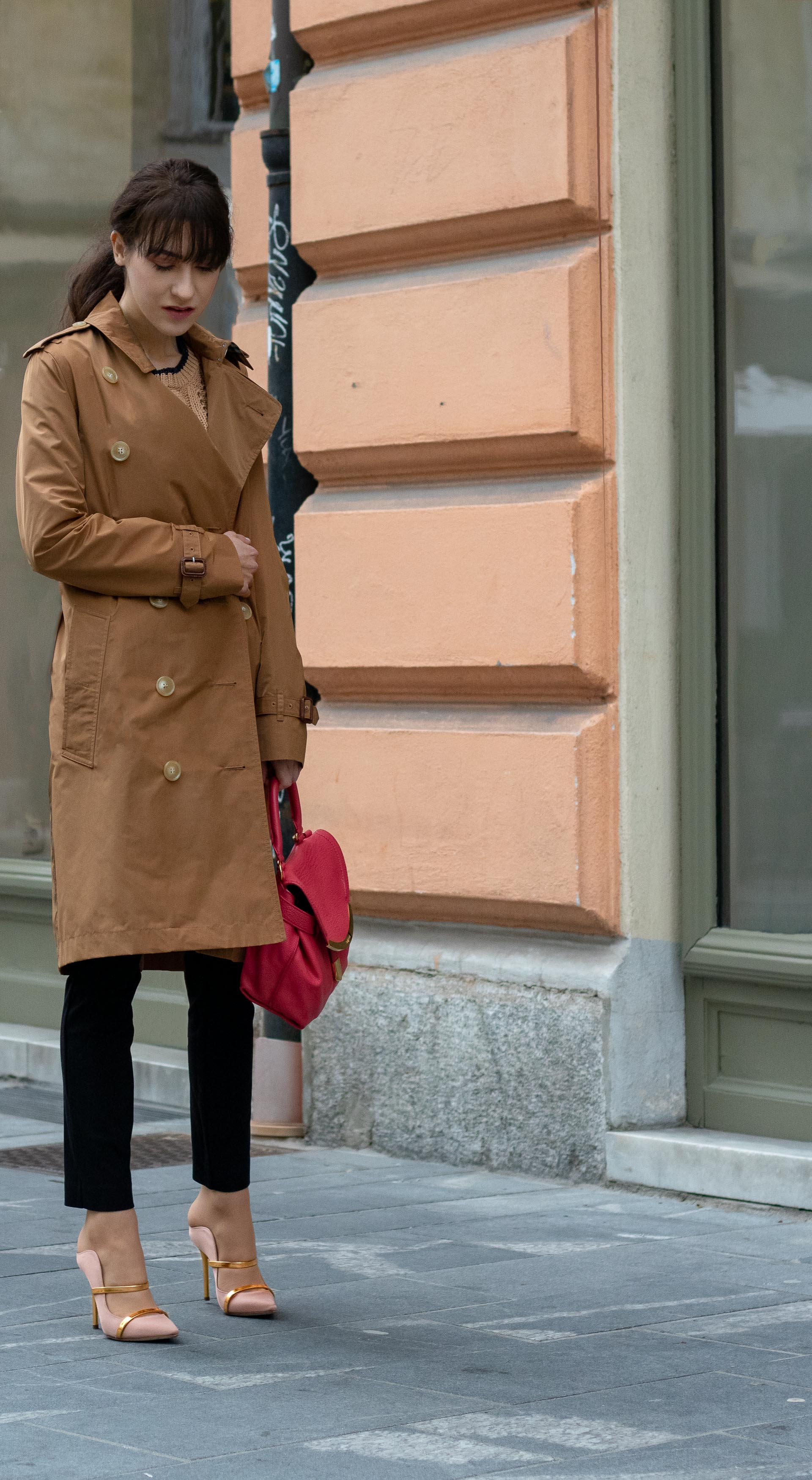 Must follow Slovenian Fashion Blogger Veronika Lipar of Brunette from Wall Street dressed in camel Burberry Kensington trench coat black slacks blush Malone Souliers mules pink top handle bag low ponytail bangs going to the office