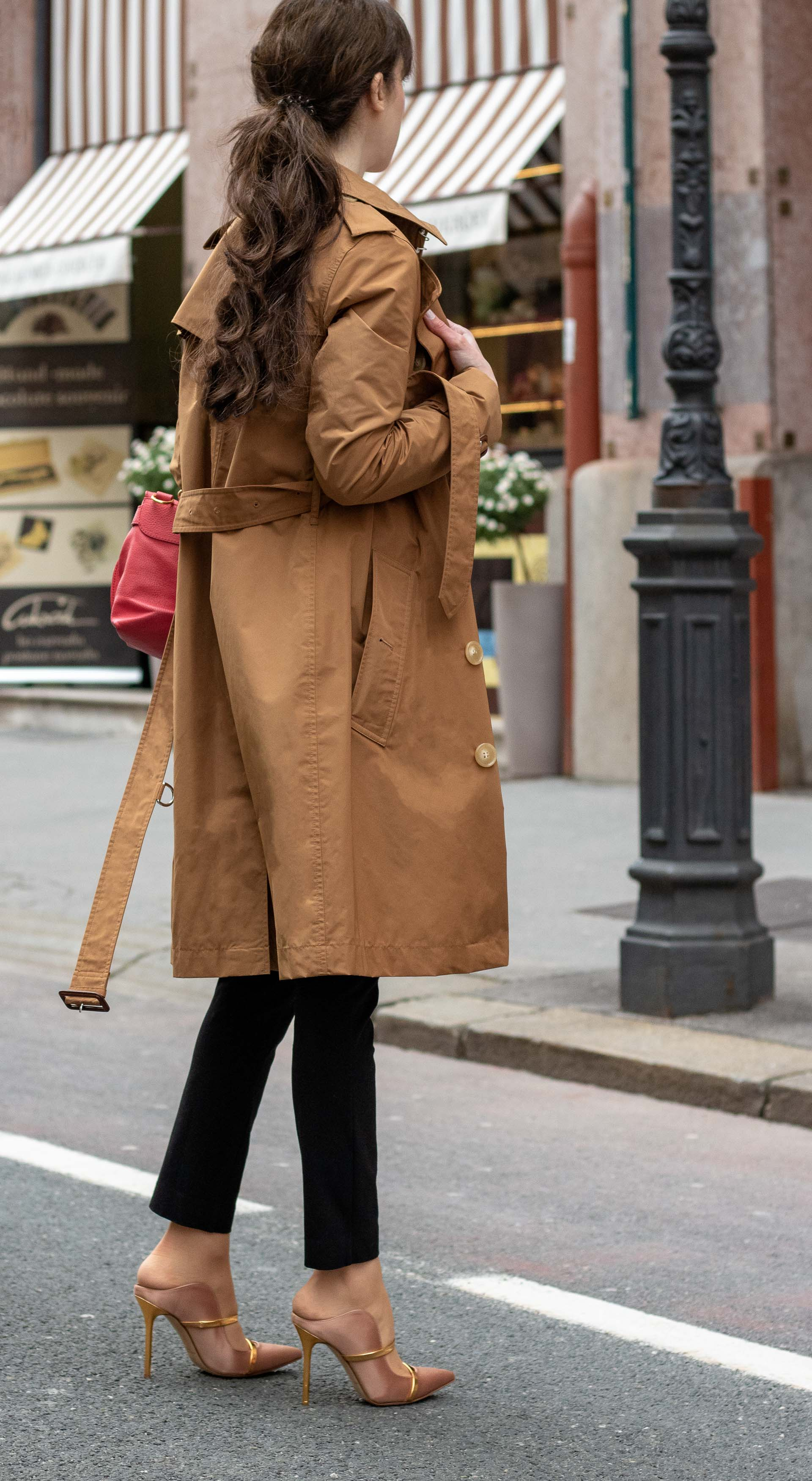 Must follow Slovenian Fashion Blogger Veronika Lipar of Brunette from Wall Street wearing camel Burberry Kensington trench coat black slacks blush Malone Souliers mules pink top handle bag low ponytail bangs going to work