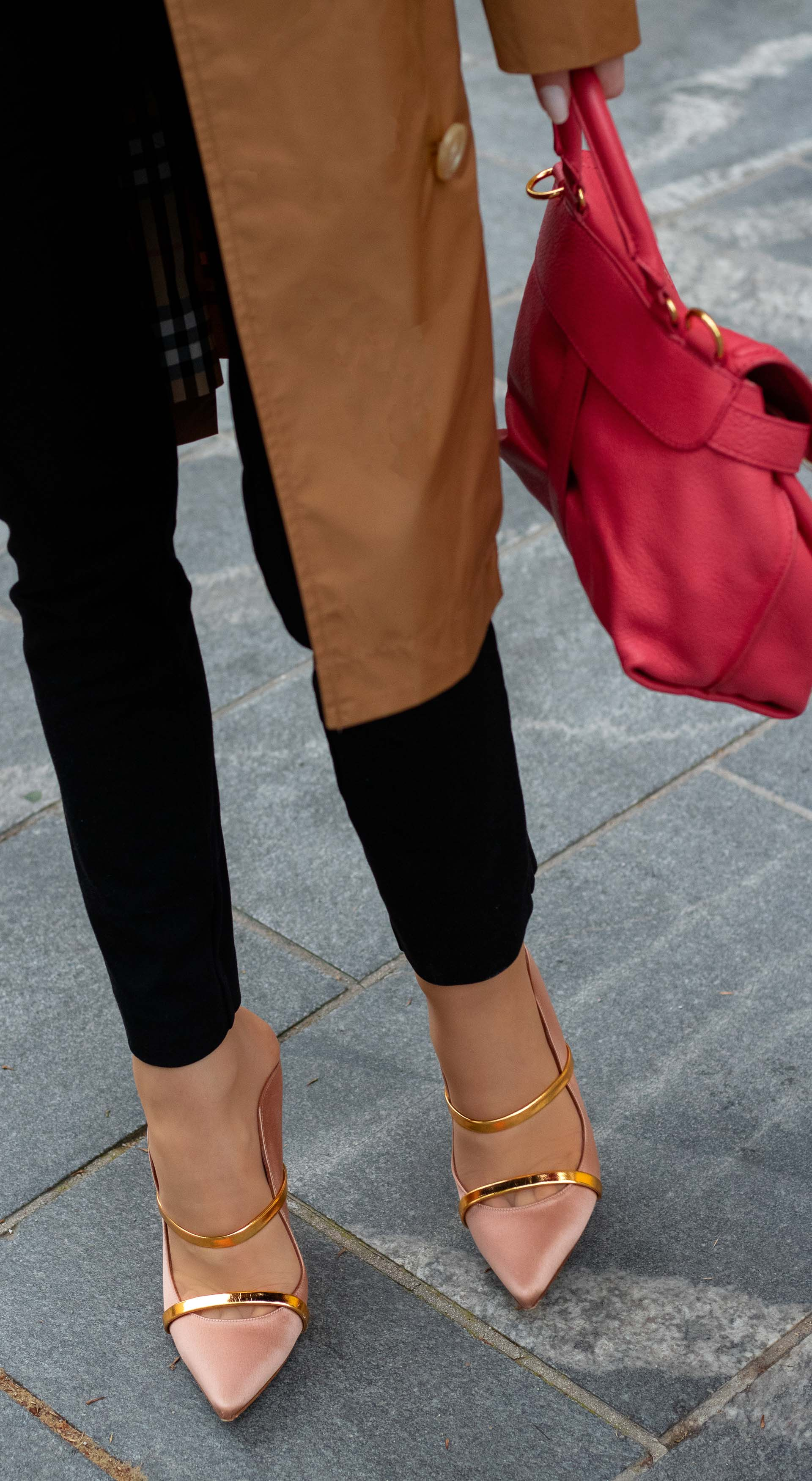 Brunette from Wall Street Burberry trench coat Malone Souliers mules pink top handle bag black slacks