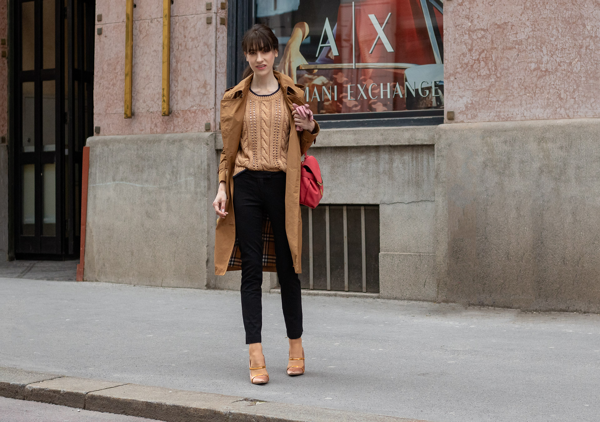 Must follow Slovenian Fashion Blogger Veronika Lipar of Brunette from Wall Street wearing camel Burberry trench coat Mango cable knit sweater black slacks blush Malone Souliers mules pink top handle bag low ponytail bangs going to the office