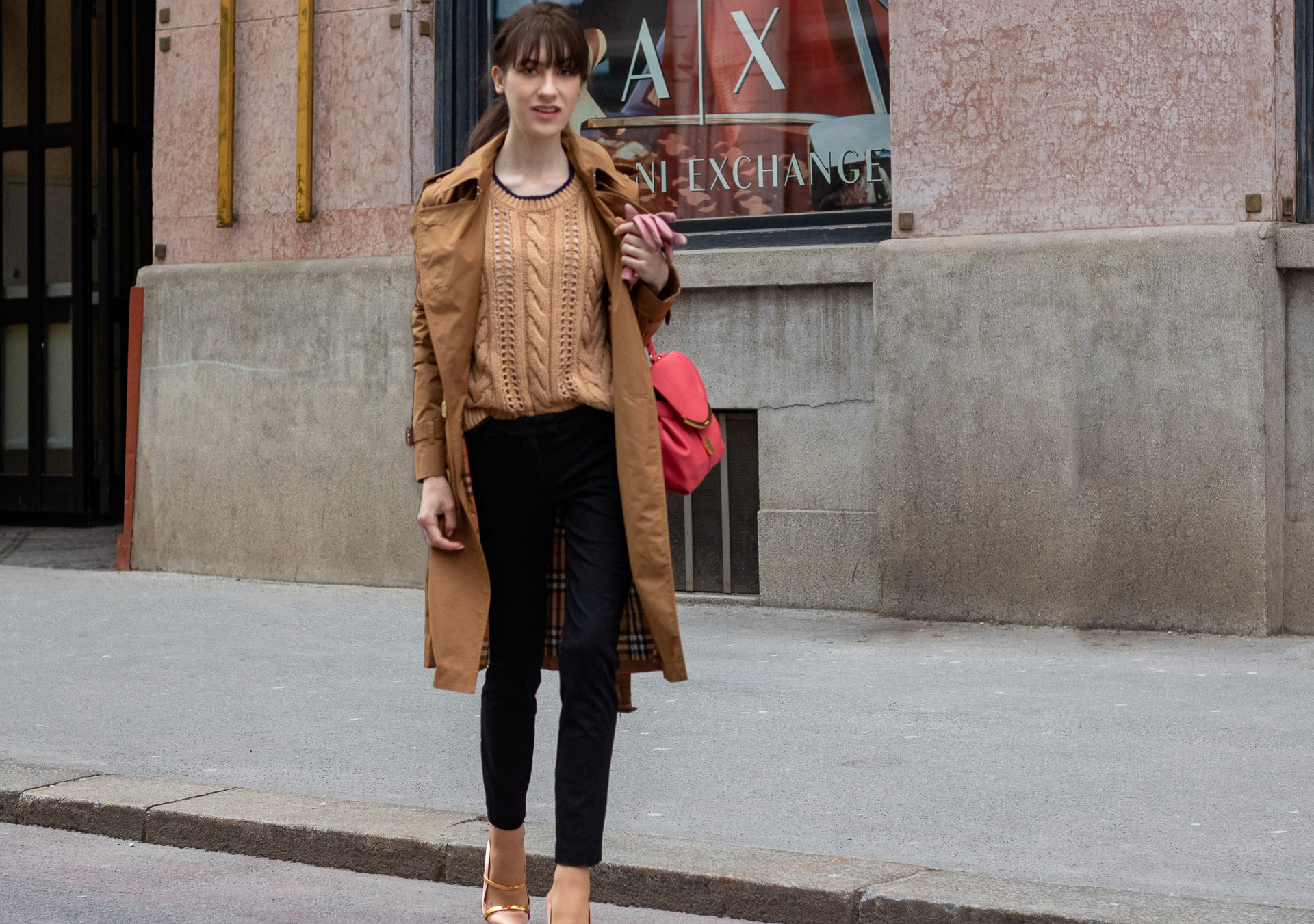 Must follow Slovenian Fashion Blogger Veronika Lipar of Brunette from Wall Street wearing camel Burberry Kensington trench coat Mango cable knit sweater black slacks blush Malone Souliers mules pink top handle bag low ponytail bangs going to work