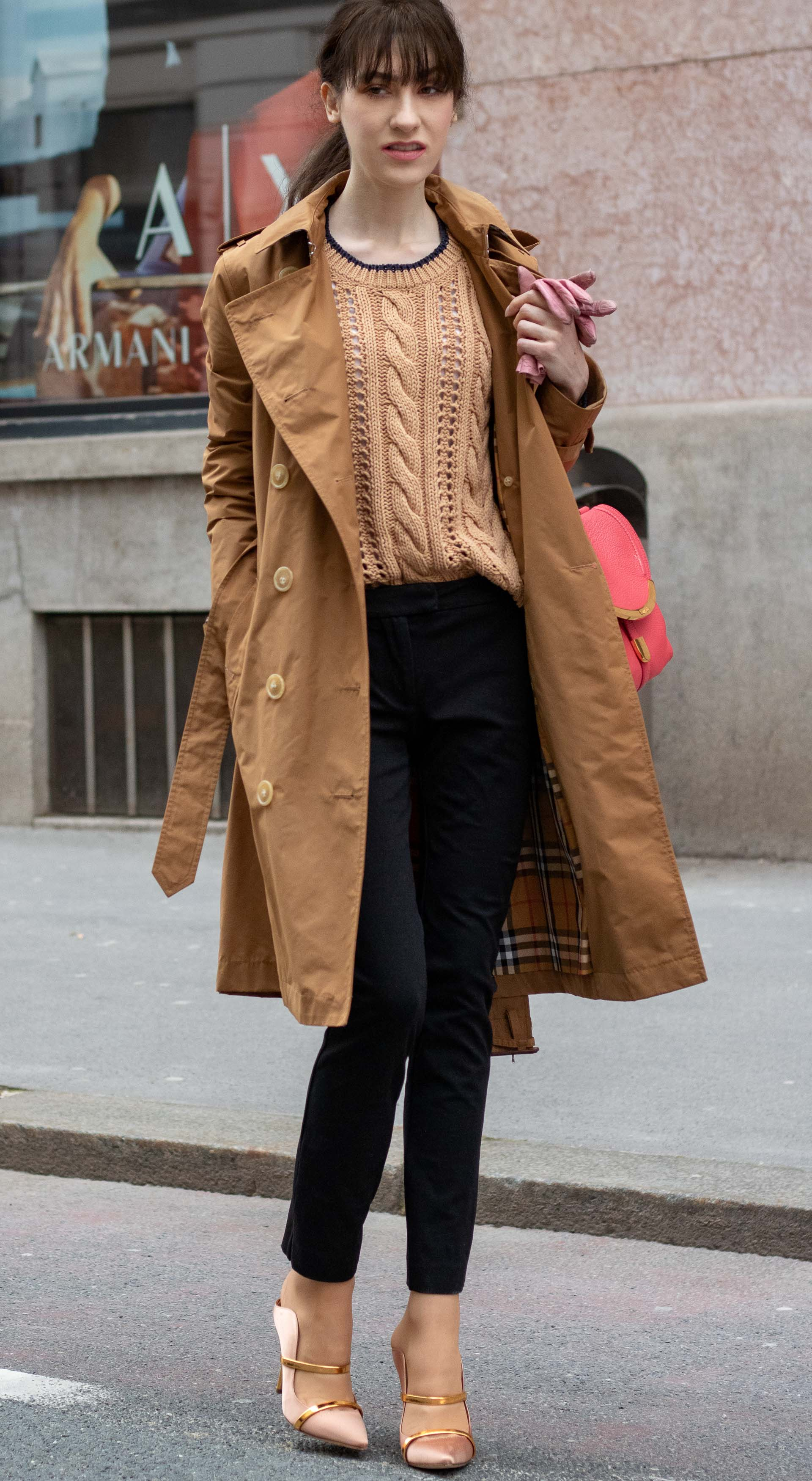 Must follow Slovenian Fashion Blogger Veronika Lipar of Brunette from Wall Street dressed in camel Burberry trench coat Mango cable knit sweater black slacks blush Malone Souliers mules pink top handle bag low ponytail bangs going to the office