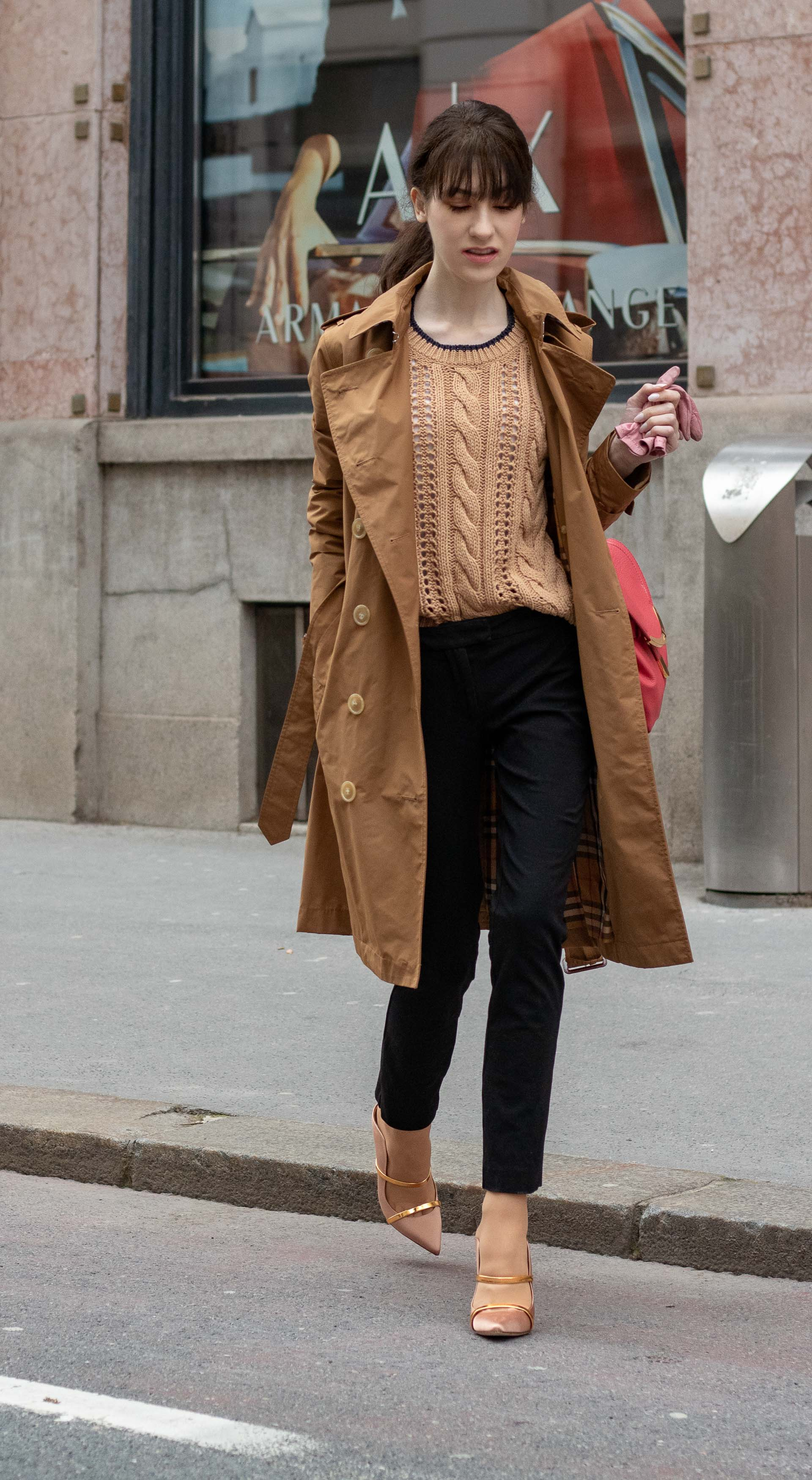 Must follow Slovenian Fashion Blogger Veronika Lipar of Brunette from Wall Street dressed in camel Burberry trench coat Mango cable knit sweater black slacks blush Malone Souliers mules pink top handle bag low ponytail bangs going to work