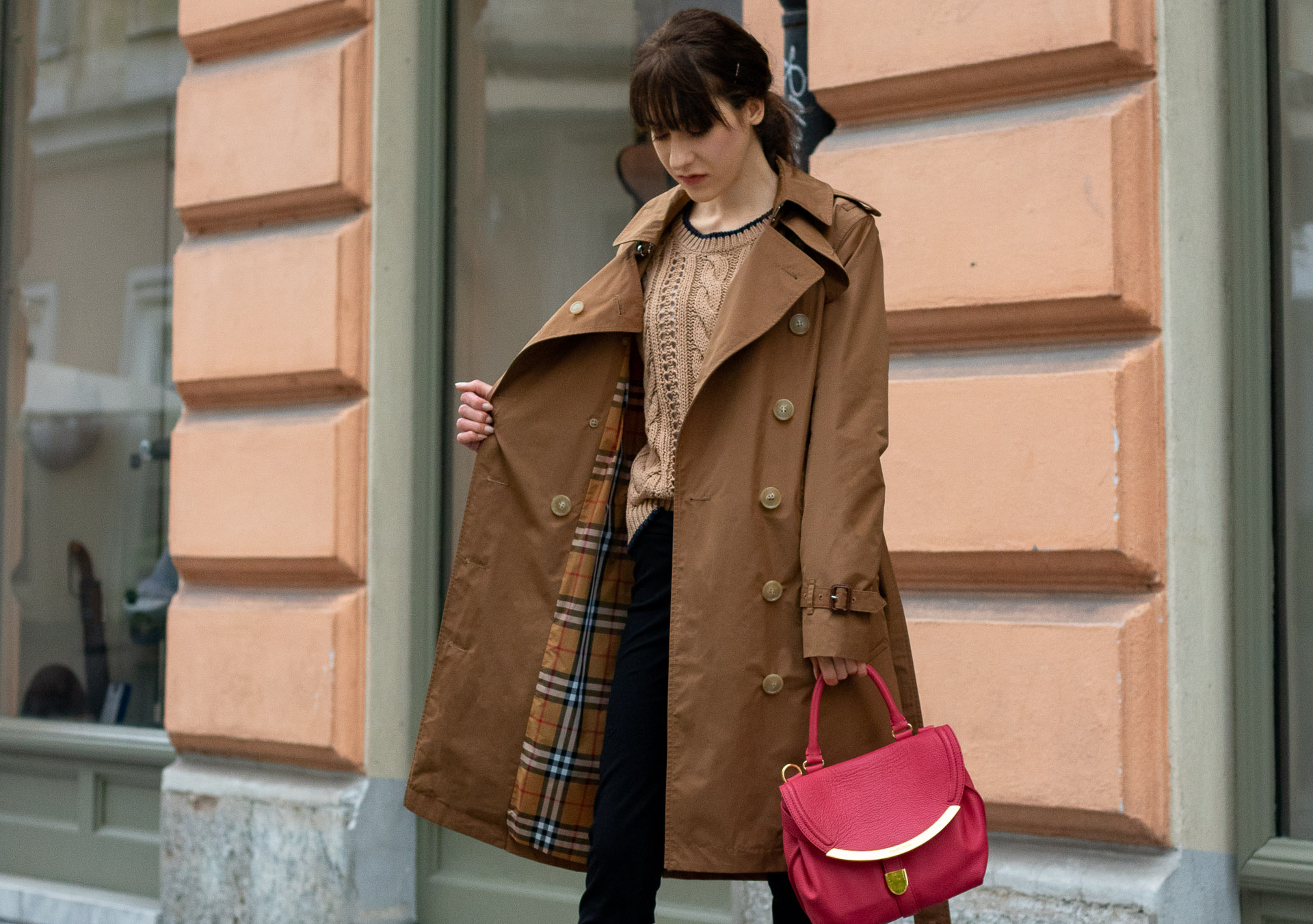 Must follow Slovenian Fashion Blogger Veronika Lipar of Brunette from Wall Street wearing camel Burberry Kensington trench coat Mango cable knit sweater pink top handle bag low ponytail bangs going to the office