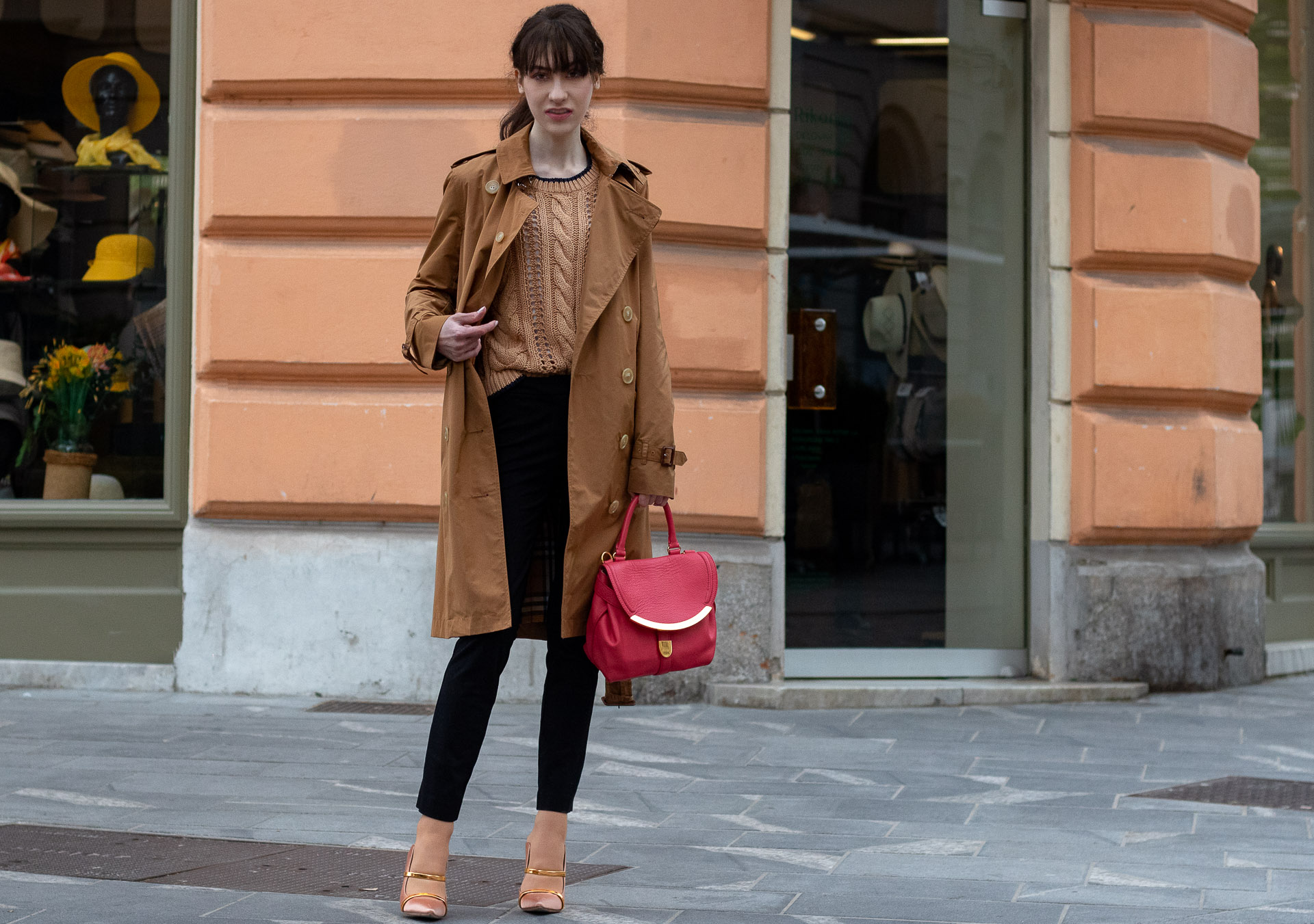 Must follow Slovenian Fashion Blogger Veronika Lipar of Brunette from Wall Street wearing camel Burberry Kensington trench coat Mango cable knit sweater black slacks blush Malone Souliers mules pink top handle bag low ponytail bangs going to the office