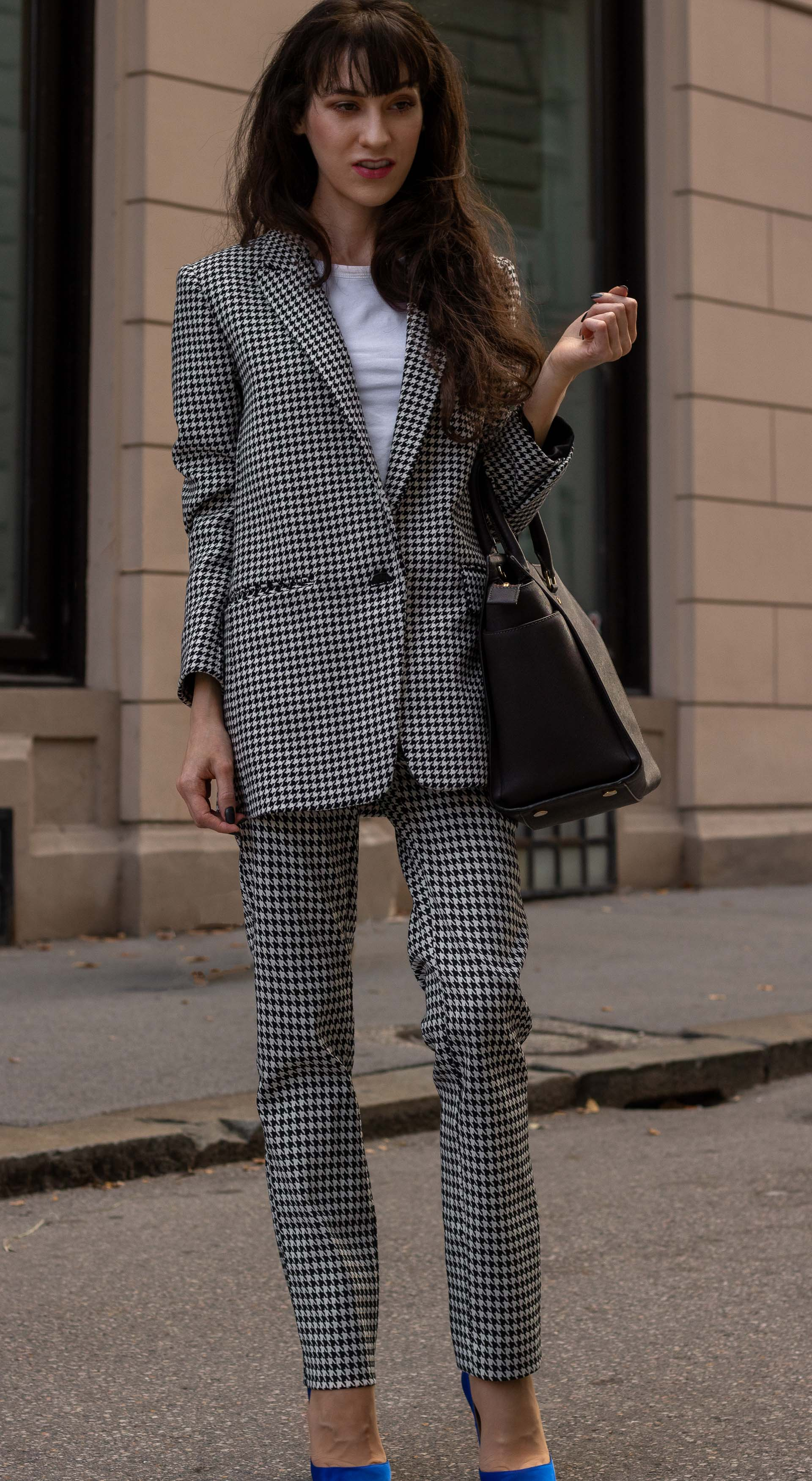 Fashion blogger Veronika Lipar of Brunette from Wall Street wearing Sandro Paris houndstooth suit Mihael Kors brown tote bag blue Gianvito Rossi pumps for work in fall