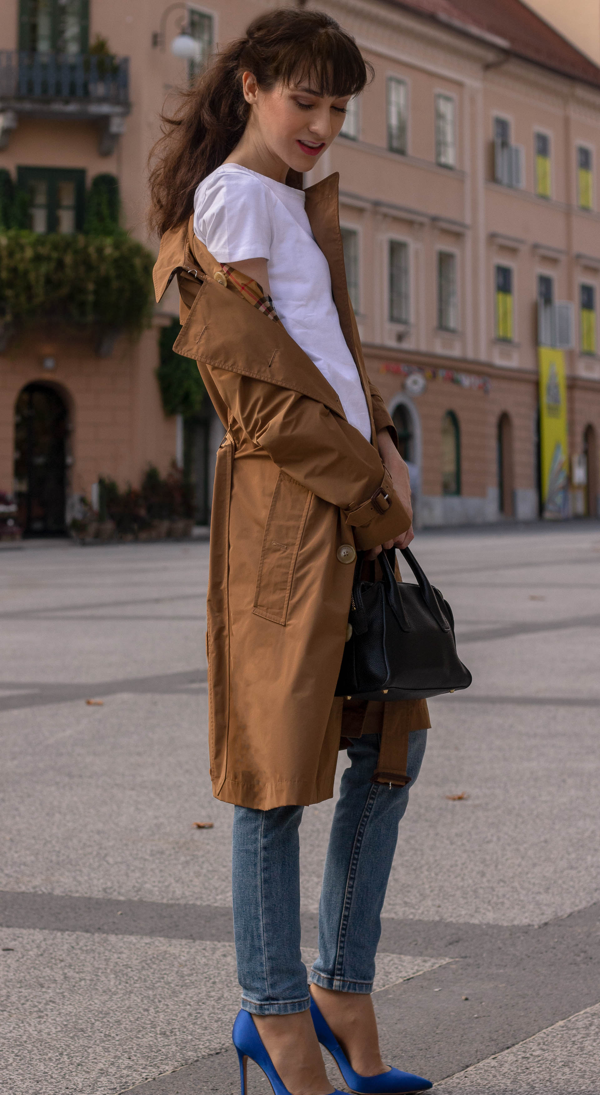Fashion blogger Veronika Lipar of Brunette from Wall Street wearing A.P.C. blue jeans white T-shirt under cookie camel Burberry trench coat blue Gianvito Rossi pumps black top handle bag in fall