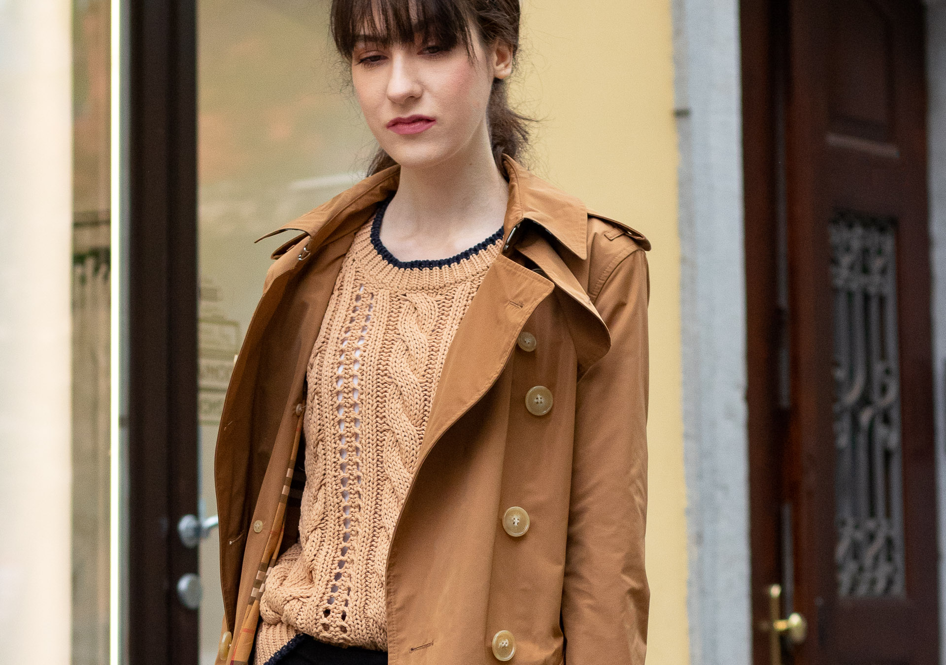 Must follow Slovenian Fashion Blogger Veronika Lipar of Brunette from Wall Street wearing camel Burberry trench coat Mango cable knit sweater low ponytail bangs going to work