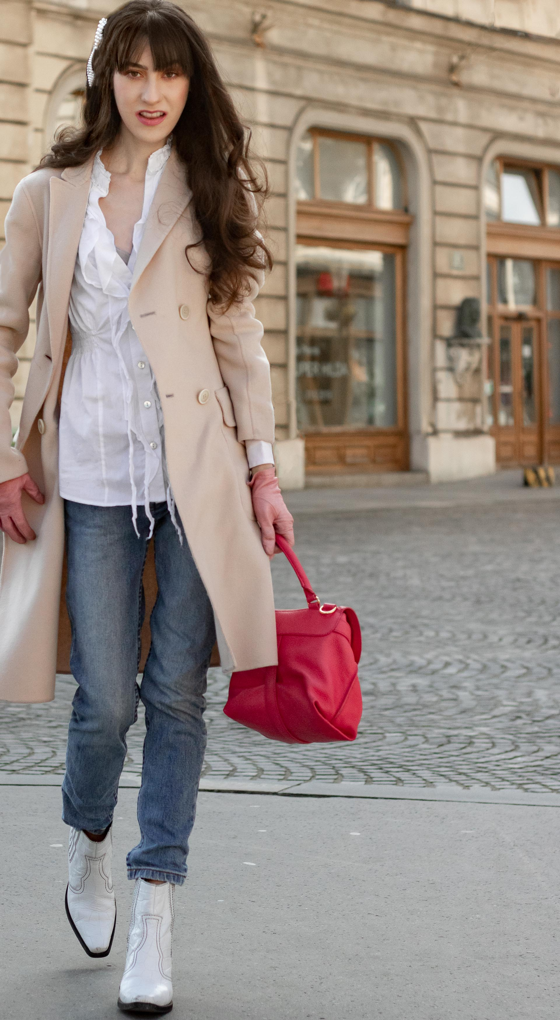 Must follow Slovenian Fashion Blogger Veronika Lipar of Brunette from Wall Street dressed in white western Ganni boots Weekend Max Mara coat white fringe shirt a.p.c. washed denim jeans pearl hair accessories See by Chloe pink top handle bag pink gloves on the street