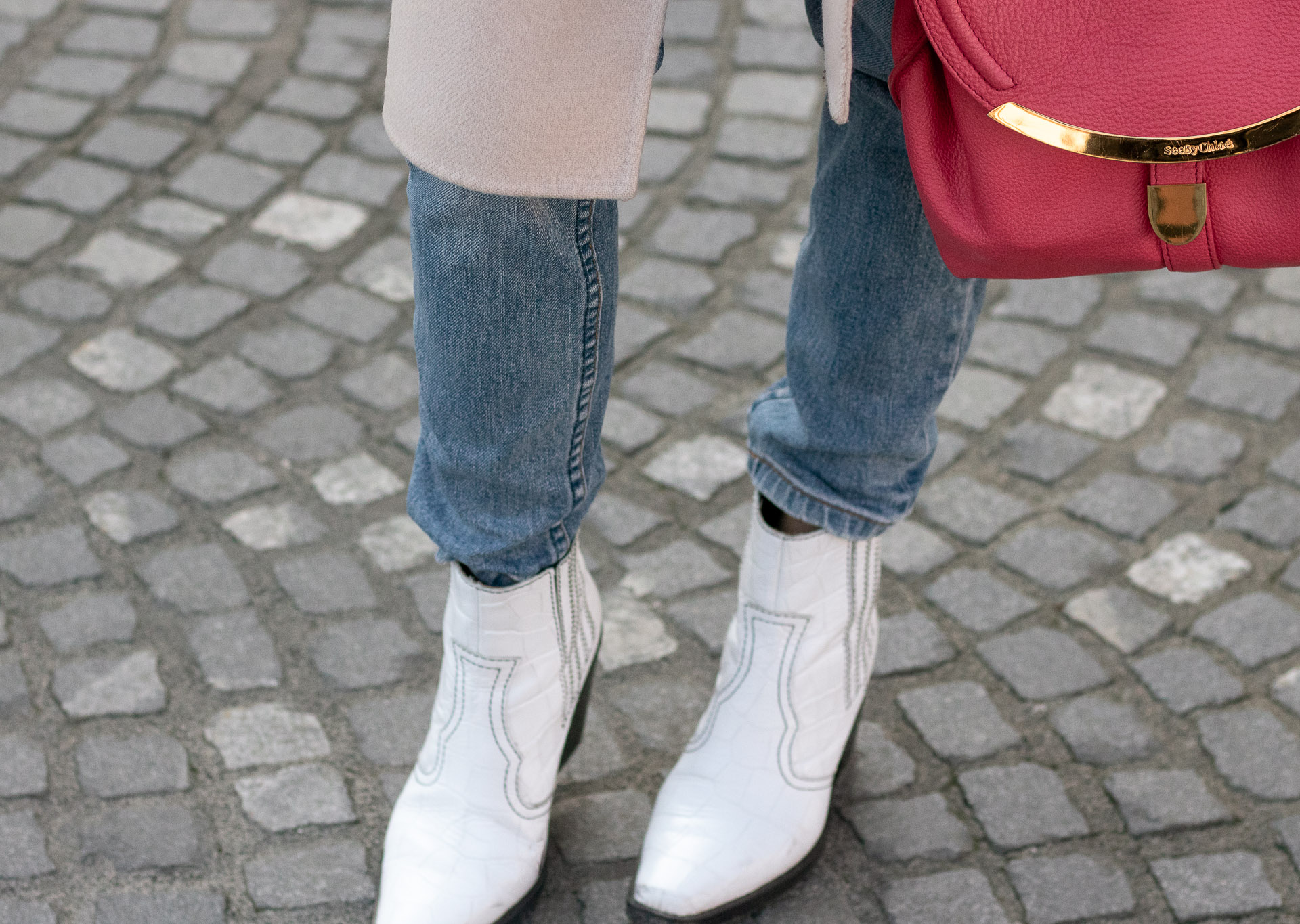 Brunette from Wall Street ganni boots washed denim jeans