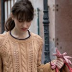 Must follow fashion blogger Veronika Lipar of Brunette from Wall Street wearing camel beige Mango cable knit camel sweater low ponytail bangs