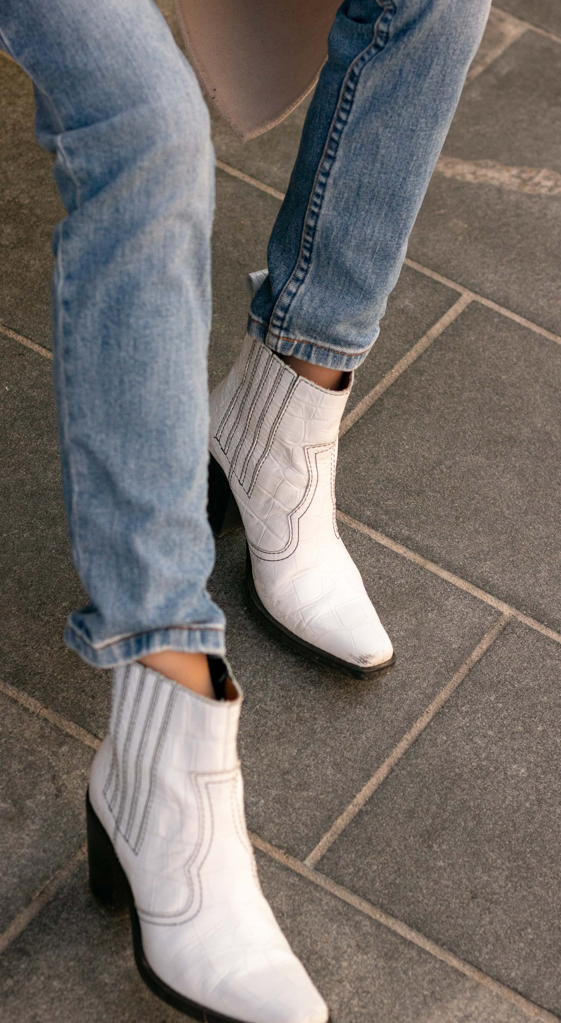 Brunette from Wall Street white western ganni boots a.p.c. washed denim jeans
