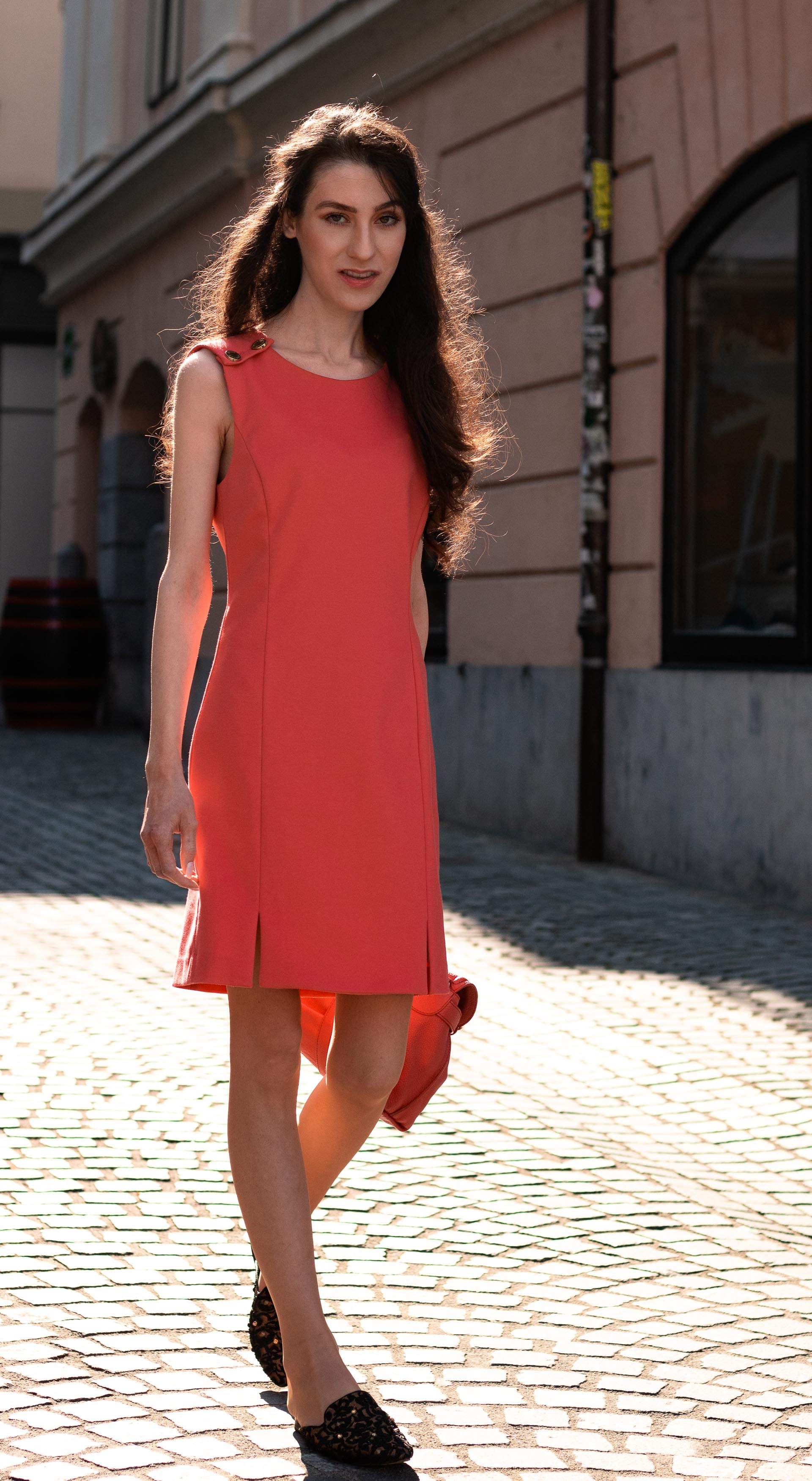Fashion Blogger Veronika Lipar of Brunette from Wall Street wearing short orange dress under blue denim jacket going to the office in the morning