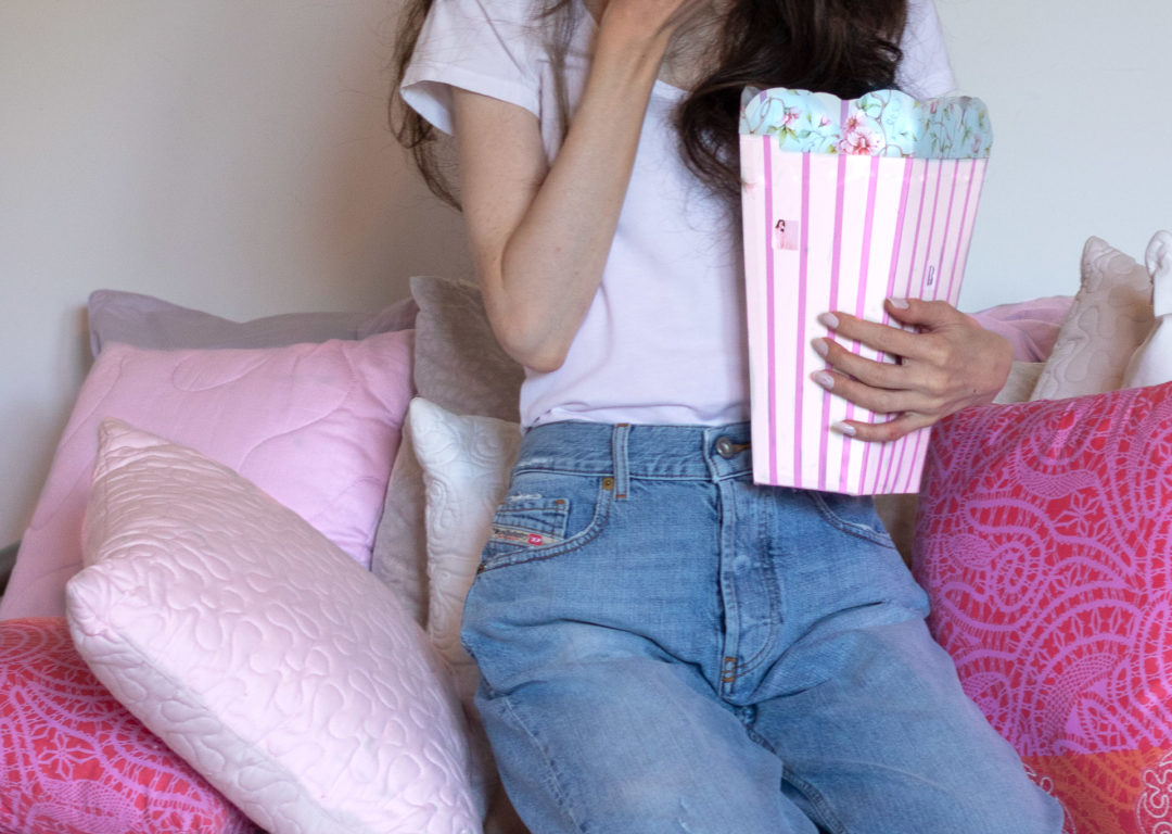 Fashion Blogger Veronika Lipar of Brunette from Wall Street wearing blue Diesel jeans and white t-shirt while Netflix and chill