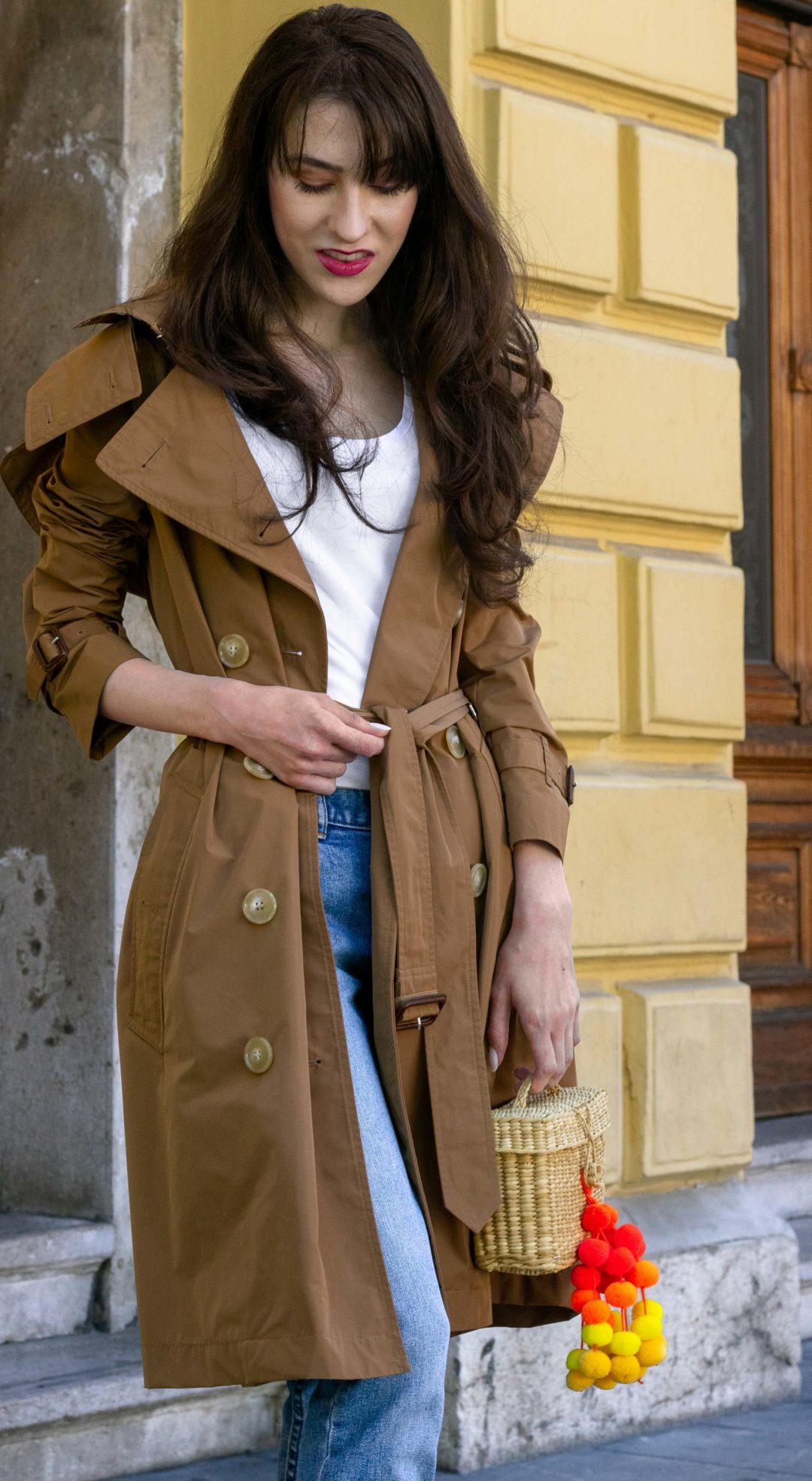 Must follow Fashion Blogger Veronika Lipar of Brunette from Wall Street wearing Burberry trench coat A.P.C. Paris blue denim jeans white T-shirt Nannacay basket bag sunglasses when it rains