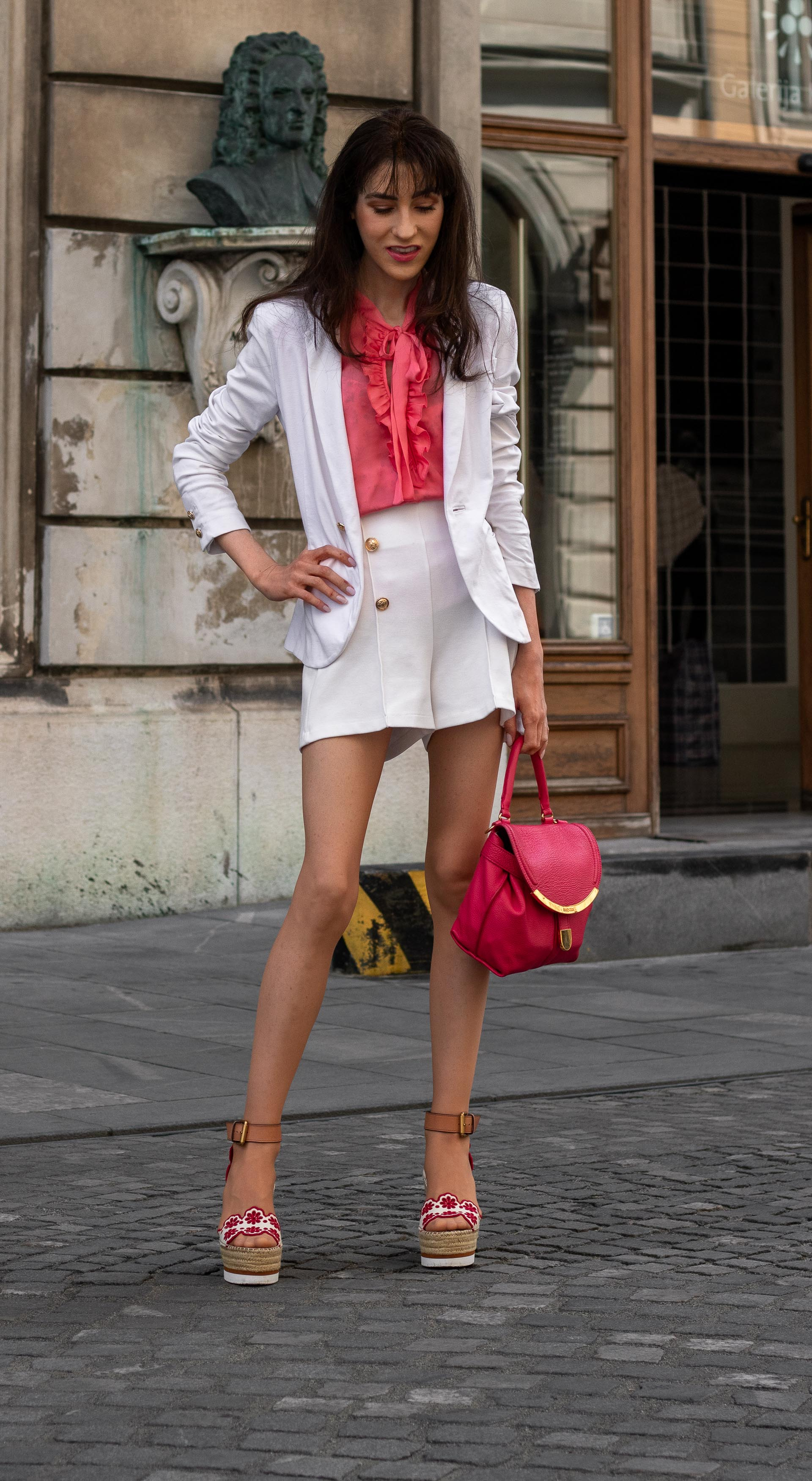Fashion Blogger Veronika Lipar of Brunette from Wall Street wearing See by Chloé wedge espadrille white shorts white blazer orange floppy tie blouse pink top handle bag in the city