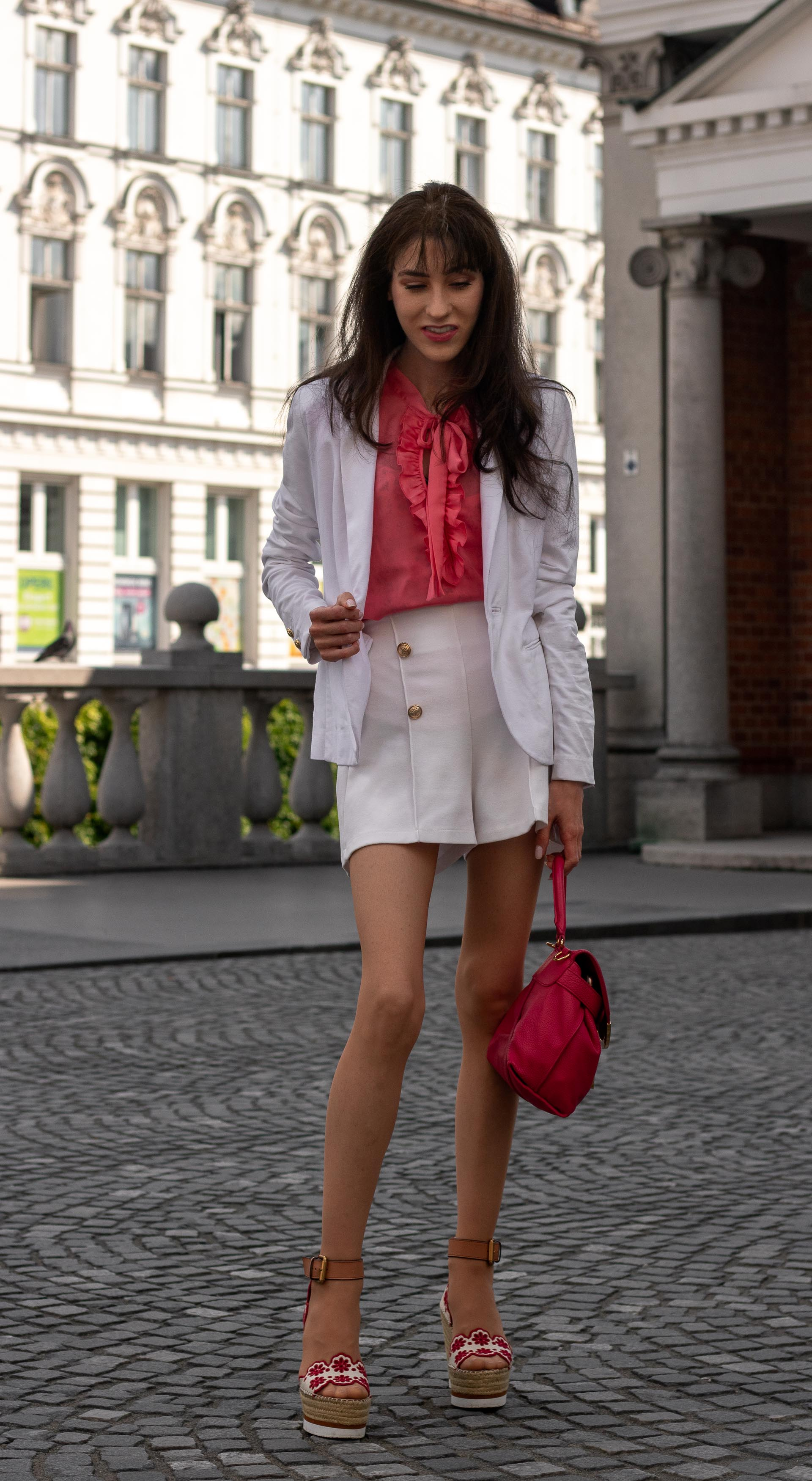 Fashion Blogger Veronika Lipar of Brunette from Wall Street wearing See by Chloé wedge espadrille white shorts white blazer orange pussy-bow blouse pink top handle bag in the city