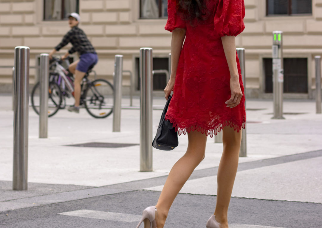 Business woman Veronika Lipar of Brunette from Wall Street dressed in Lovers + Friends red dress Gianvito Rossi plexi pumps black top handle bag going to work in summer