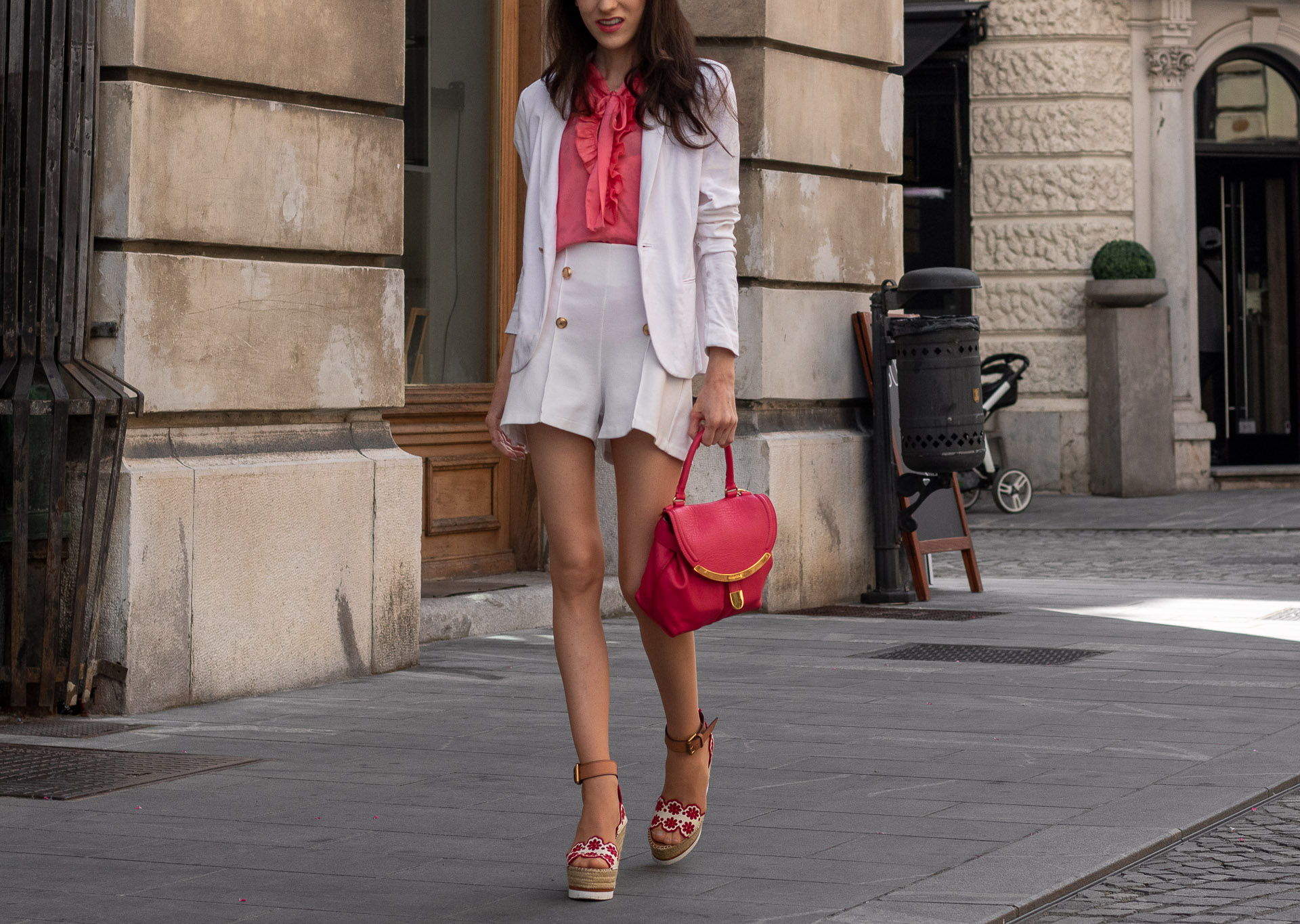 Fashion Blogger Veronika Lipar of Brunette from Wall Street dressed in See by Chloé wedge espadrille white shorts white blazer orange floppy tie blouse pink top handle bag in the city