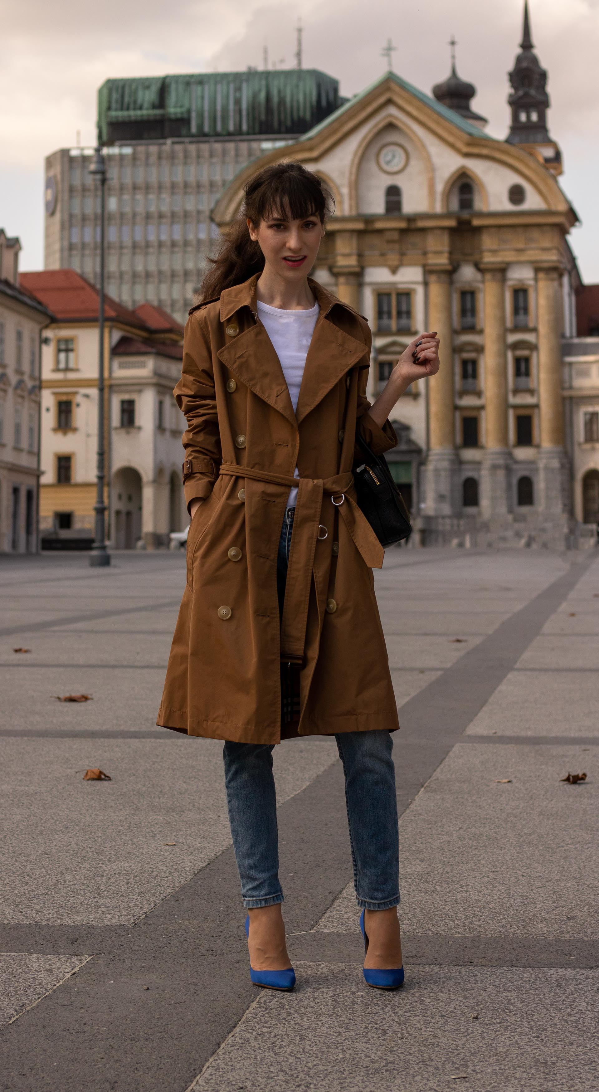 Fashion blogger Veronika Lipar of Brunette from Wall Street dressed in A.P.C. blue jeans white T-shirt under cookie camel Burberry trench coat blue Gianvito Rossi pumps black top handle bag in fall