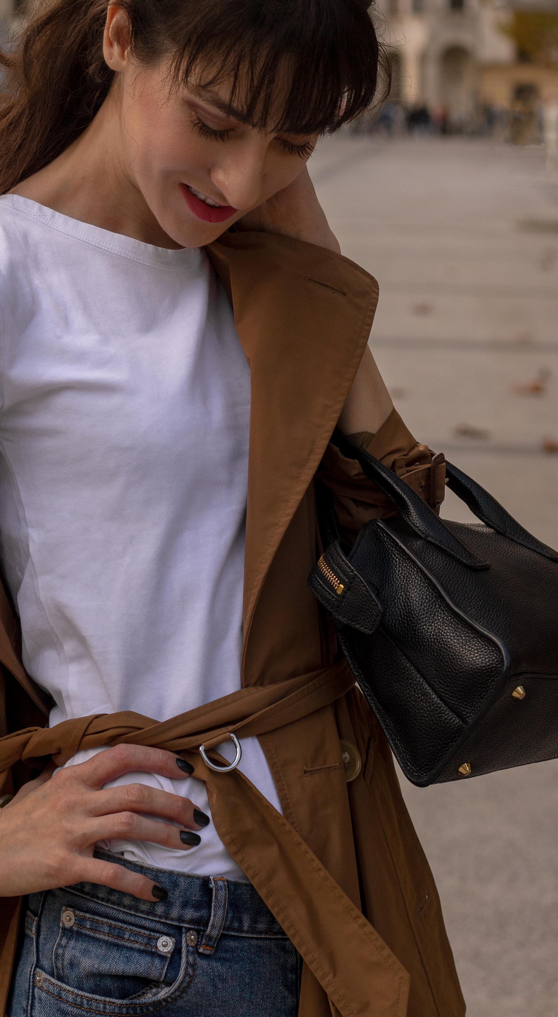 Fashion blogger Veronika Lipar of Brunette from Wall Street wearing white T-shirt blue jeans with camel Burberry trench coat black top handle bag in fall