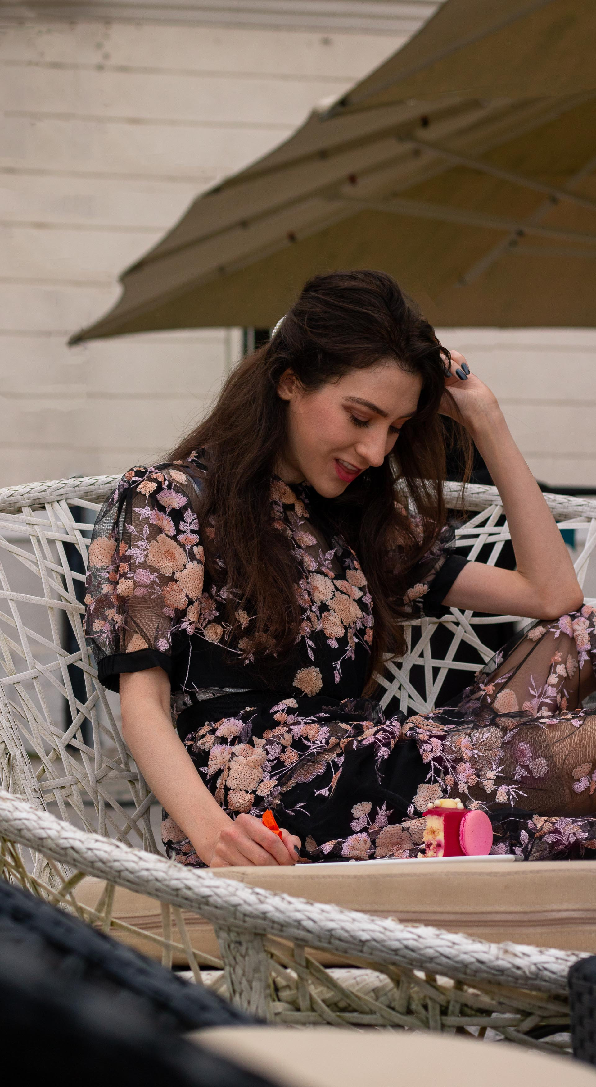 Fashion blogger Veronika Lipar of Brunette from Wall Street wearing Self Portrait Short Sleeve Floral Mesh Midi Dress at her birthday brunch party