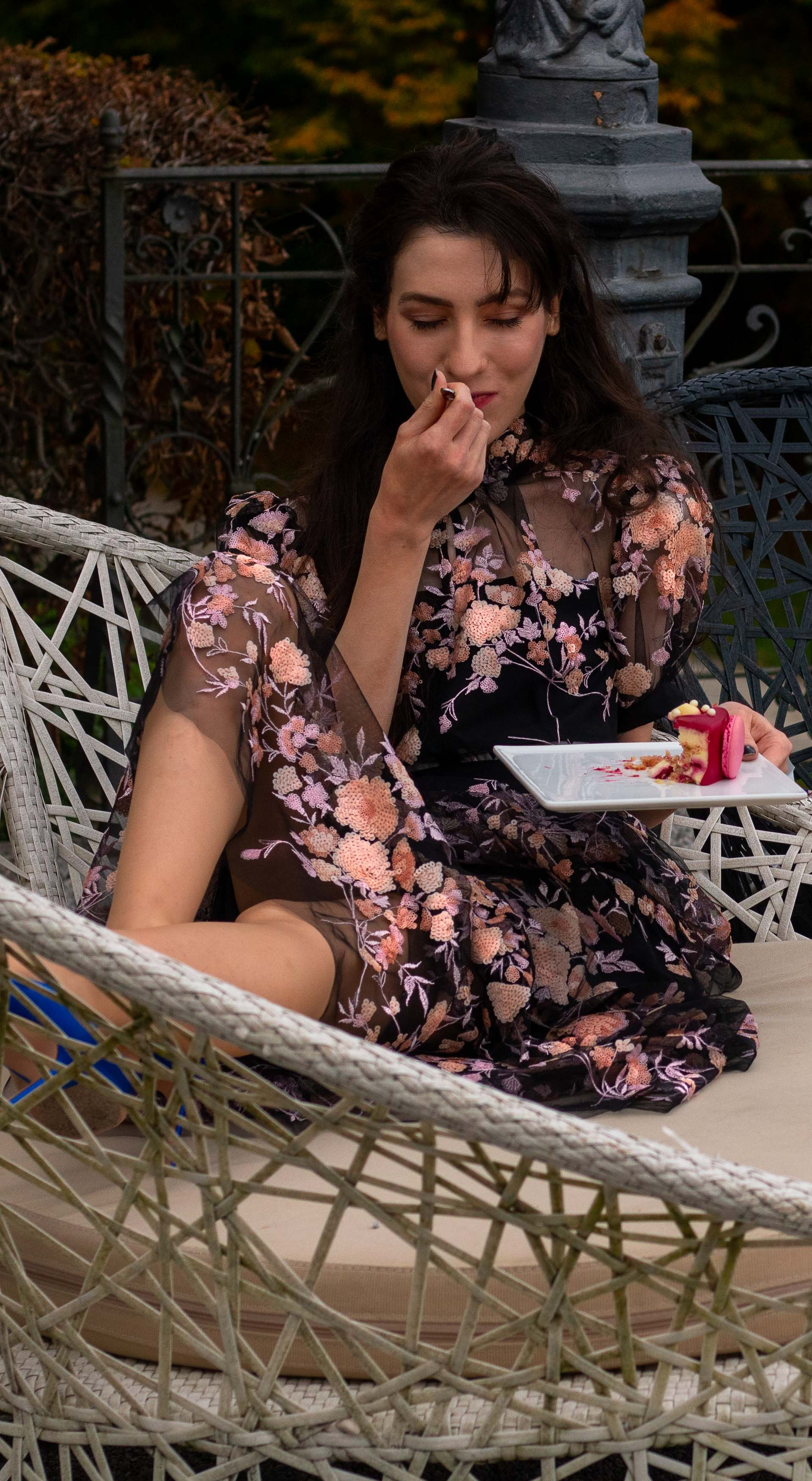 Fashion blogger Veronika Lipar of Brunette from Wall Street wearing Self Portrait black floral embroidered dress Gianvito Rossi blue pumps eating birthday cake