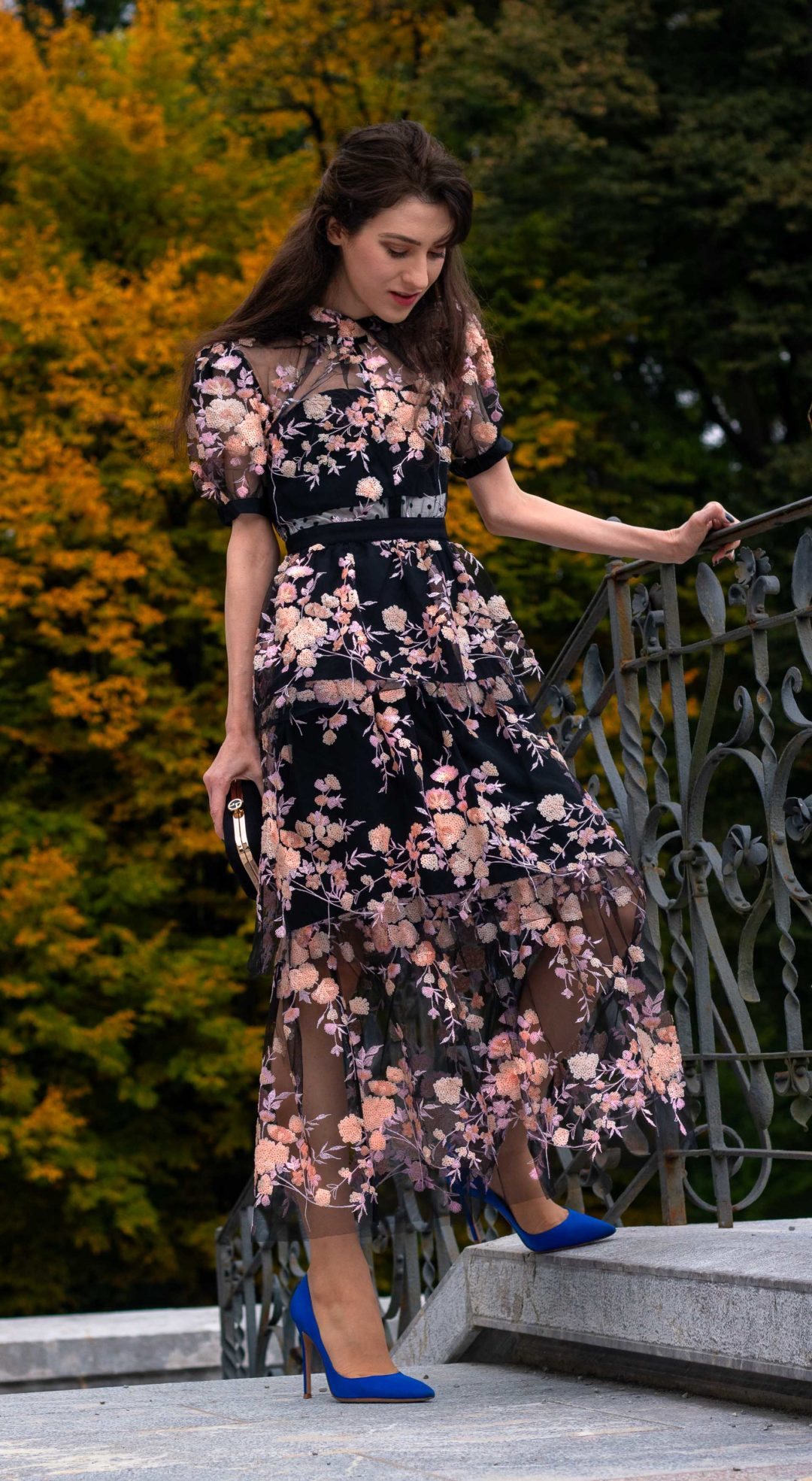 Fashion blogger Veronika Lipar of Brunette from Wall Street dressed in Self Portrait Short Sleeve Floral Mesh Midi Dress Gianvito Rossi blue pumps at her birthday party