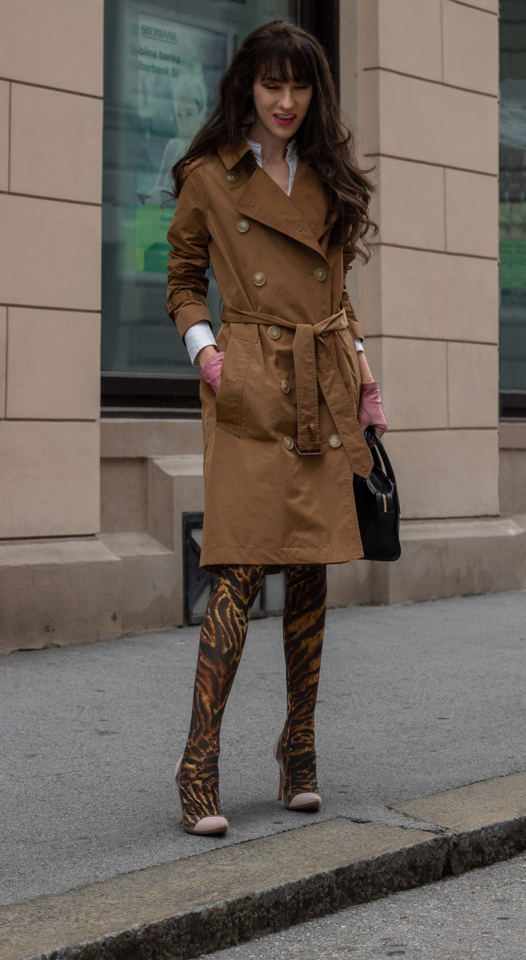Fashion blogger Veronika Lipar of Brunette from Wall Street wearing camel Burberry trench coat Ganni tiger print tights Gianvito Rossi plexi pumps pink gloves black top handle bag everyday