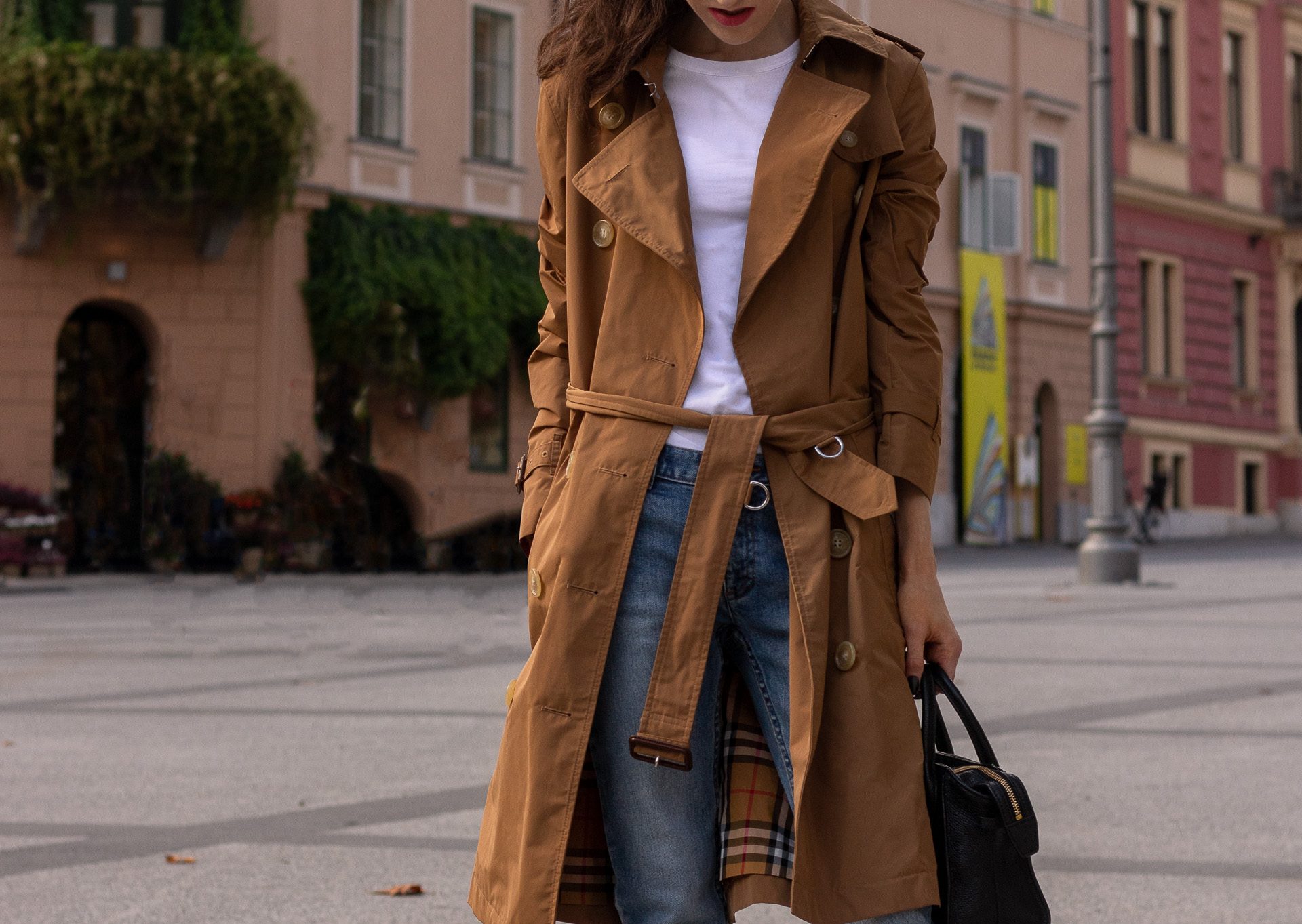 Fashion blogger Veronika Lipar of Brunette from Wall Street wearing A.P.C. blue jeans white T-shirt under cookie camel Burberry trench coat in fall