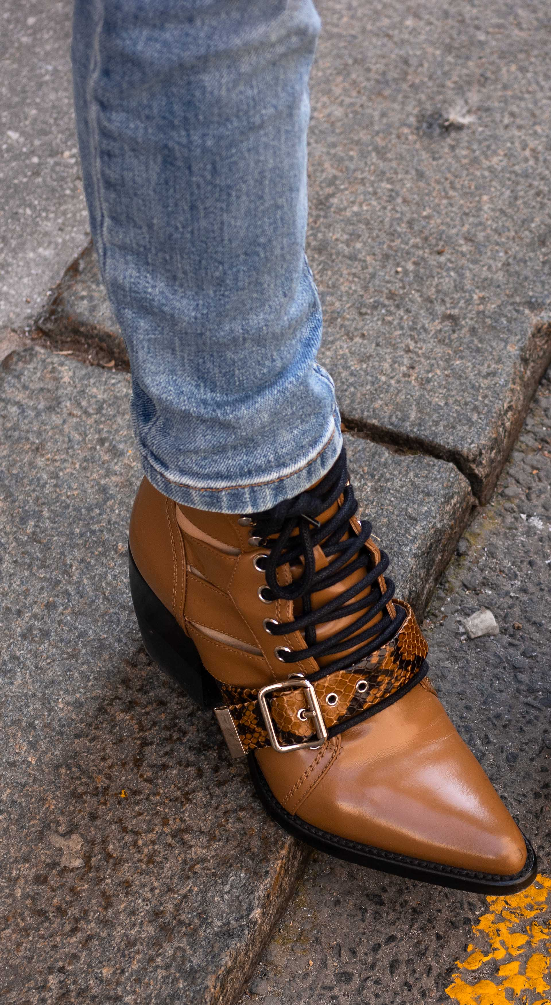 Brunette from Wall Street chloé rylee boot blue jeans
