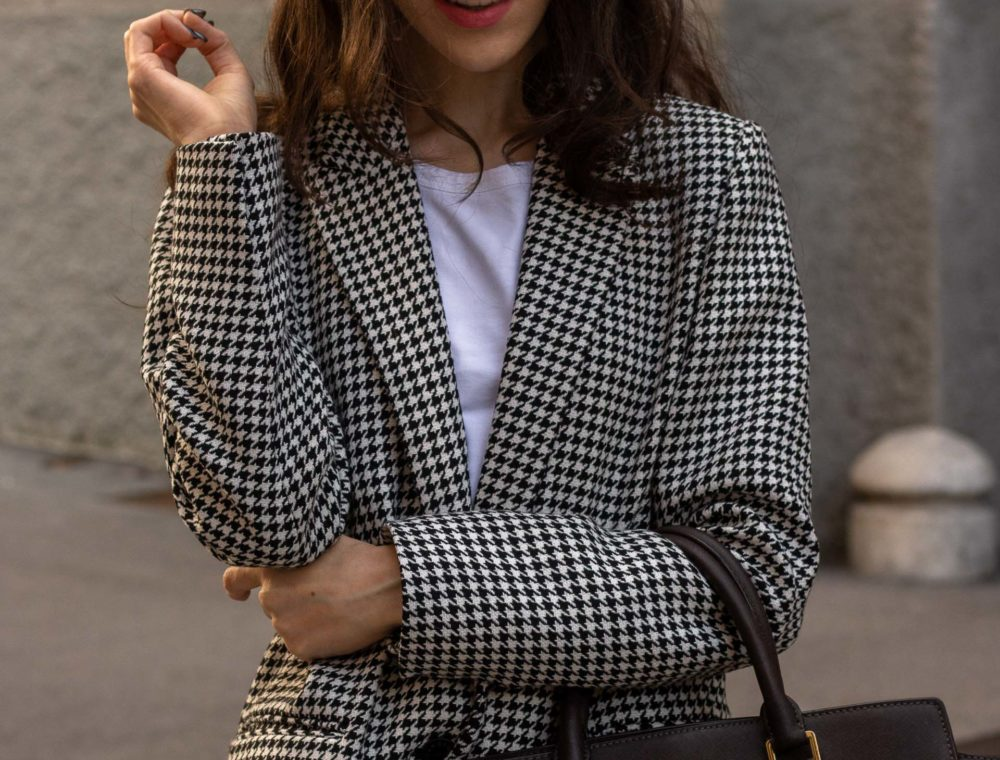 Fashion blogger Veronika Lipar of Brunette from Wall Street wearing white Sandro houndstooth tailored blazer European Culture houndstooth pants Michael Kors Selma bag for work in fall