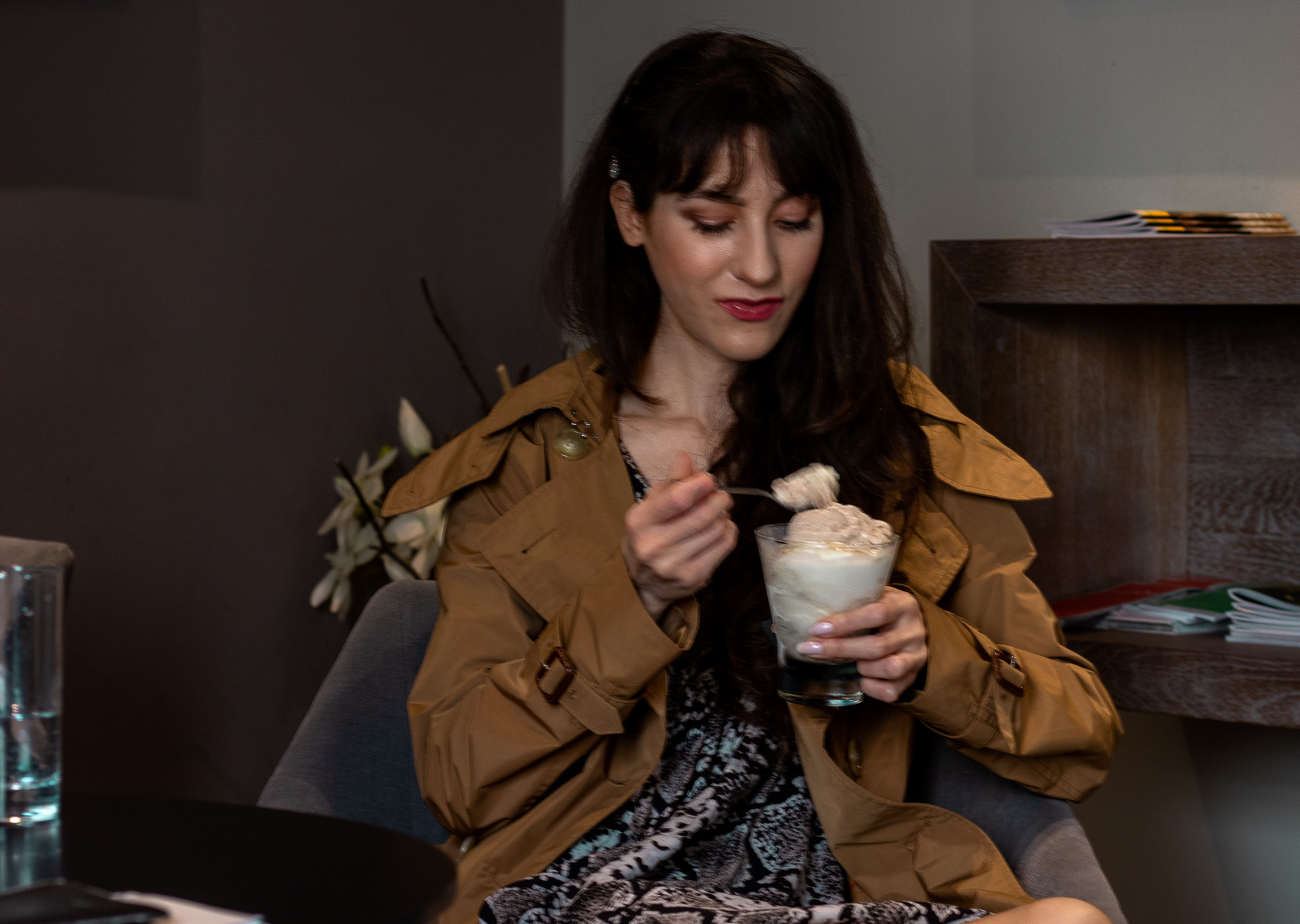 Fashion blogger Veronika Lipar of Brunette from Wall Street wearing Burberry trench coat short snakeskin dress eating ice cream on a date with BFFs