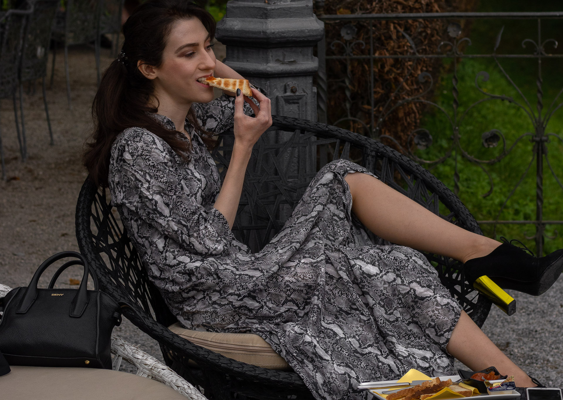Fashion blogger Veronika Lipar of Brunette from Wall Street wearing grey long snakeskin print dress black Fendi ankle boots with golden heels eating peanut & jelly toast at brunch with BFFs in fall
