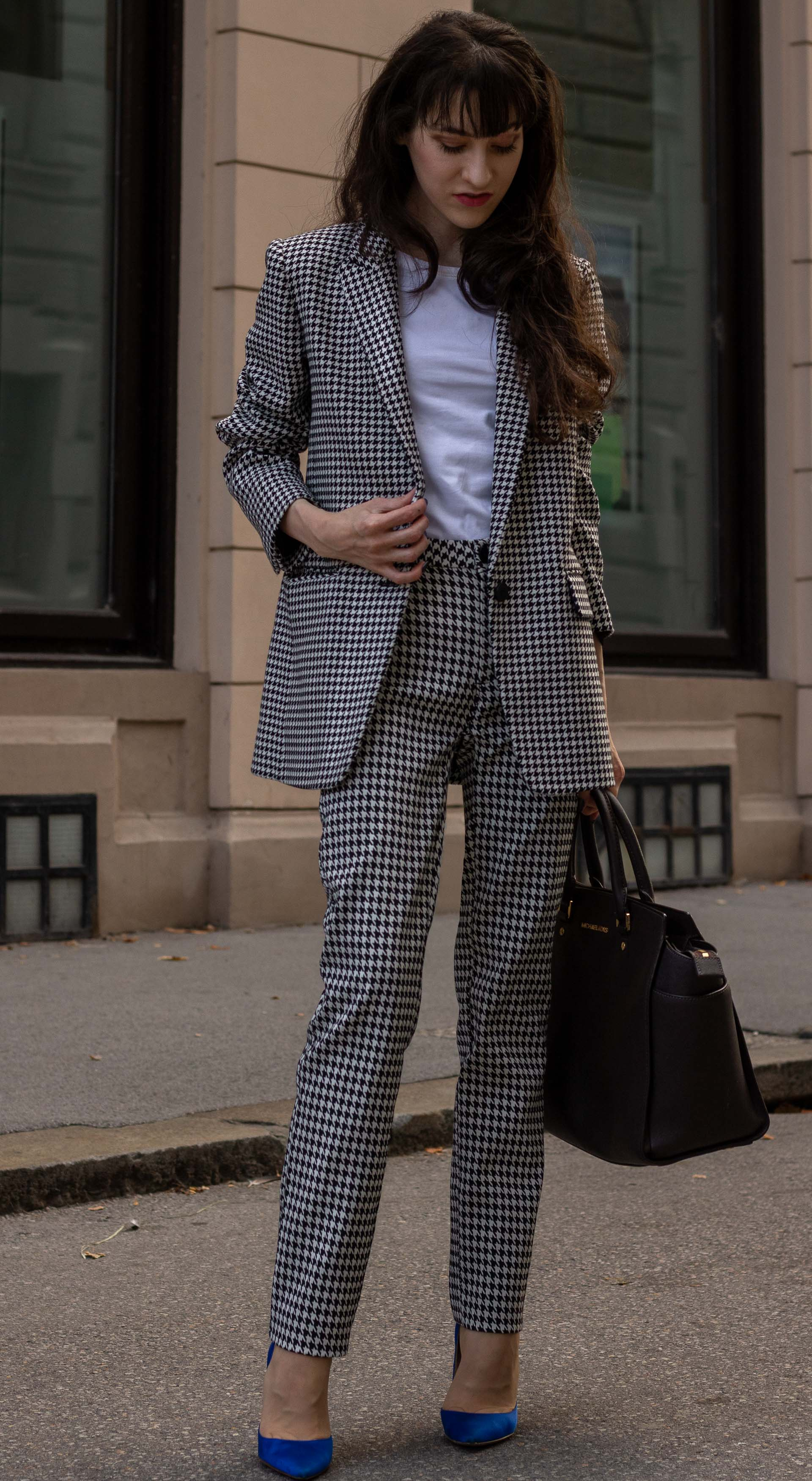 Fashion blogger Veronika Lipar of Brunette from Wall Street wearing white Sandro houndstooth tailored blazer European Culture houndstooth pants Michael Kors Selma bag blue Gianvito Rossi court shoes for office in fall