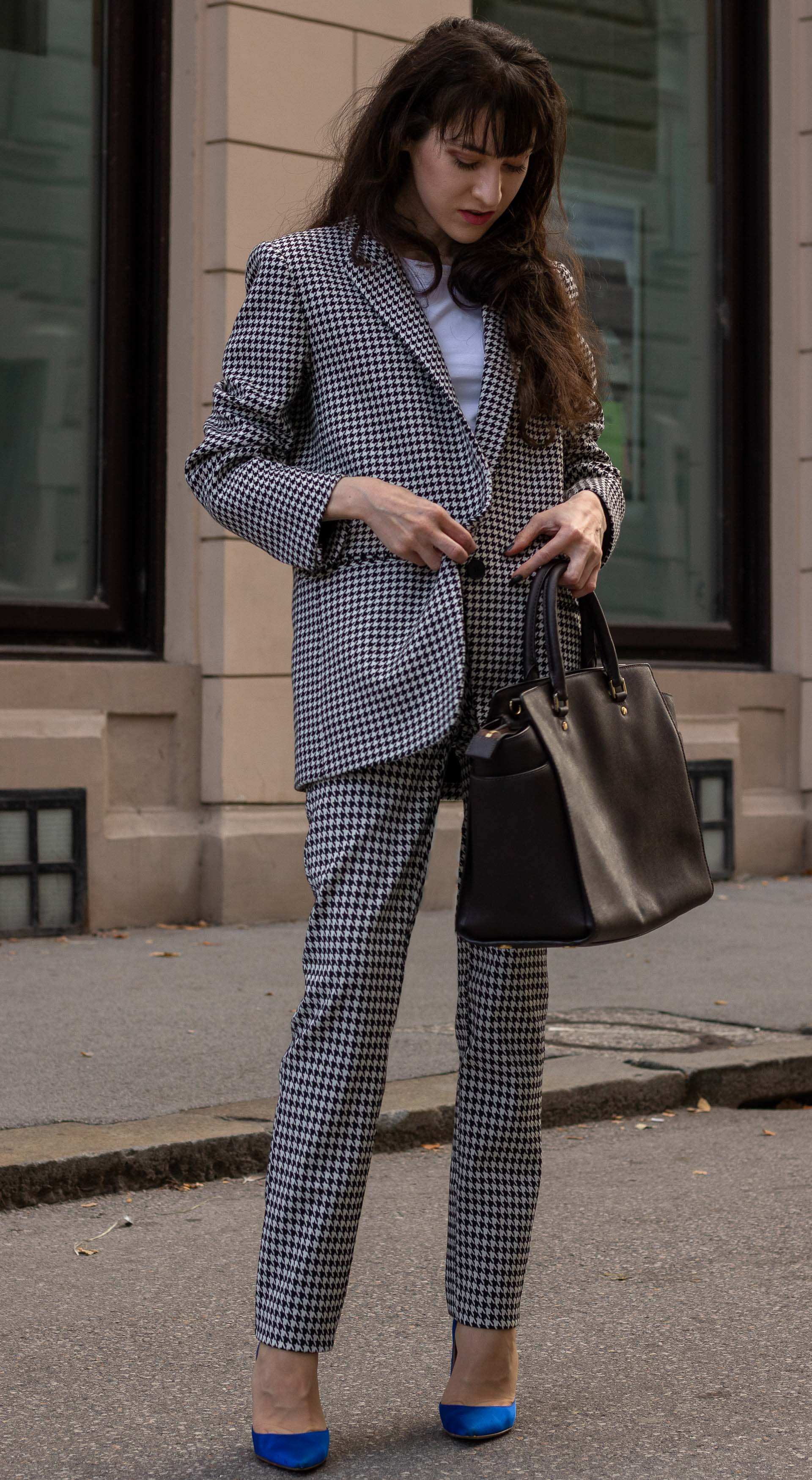Fashion blogger Veronika Lipar of Brunette from Wall Street wearing white Sandro houndstooth tailored blazer European Culture houndstooth pants Michael Kors Selma bag blue Gianvito Rossi pumps for office in fall