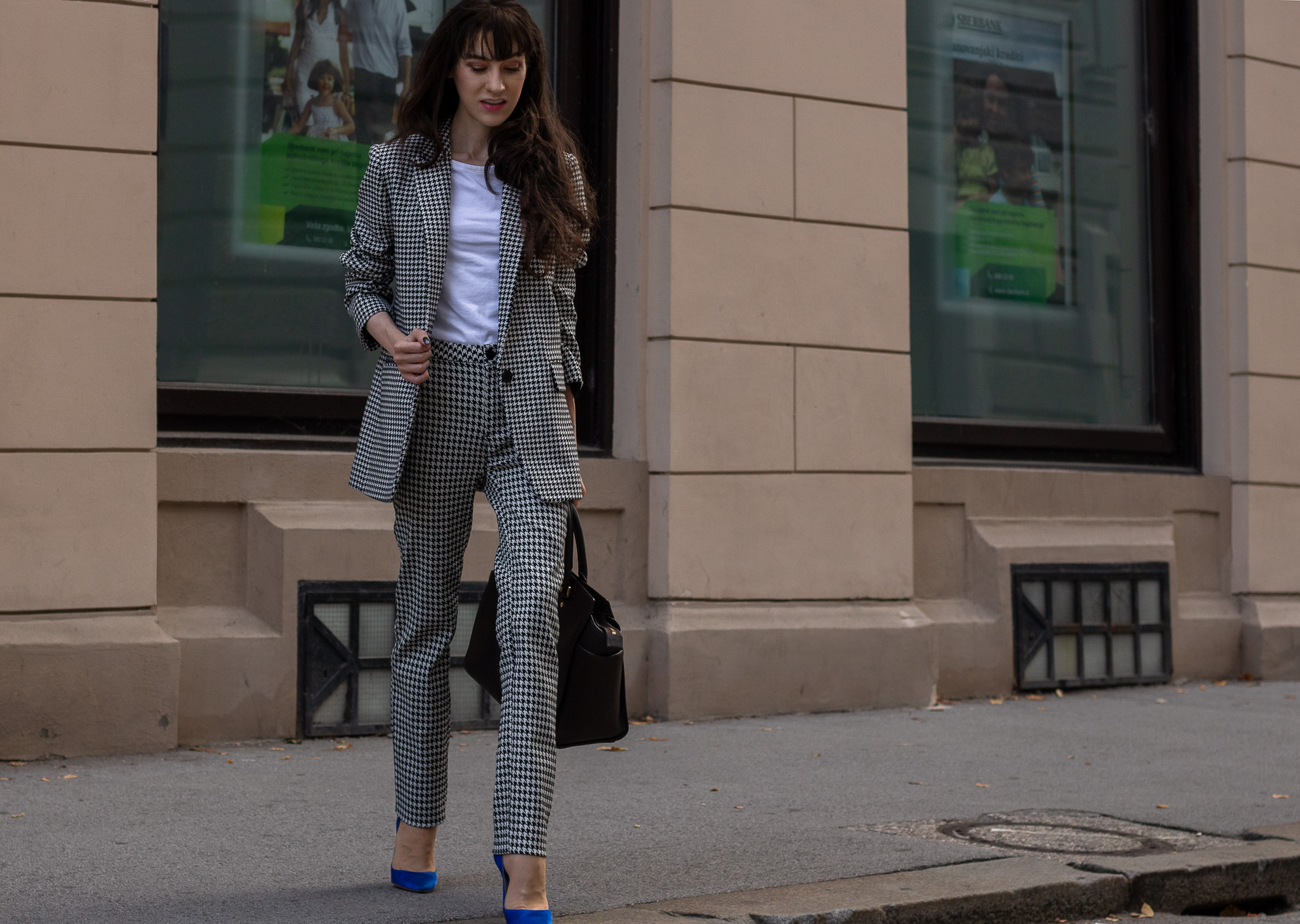 Fashion blogger Veronika Lipar of Brunette from Wall Street wearing white Sandro houndstooth tailored blazer European Culture houndstooth pants Michael Kors Selma bag blue Gianvito Rossi pumps for work in fall