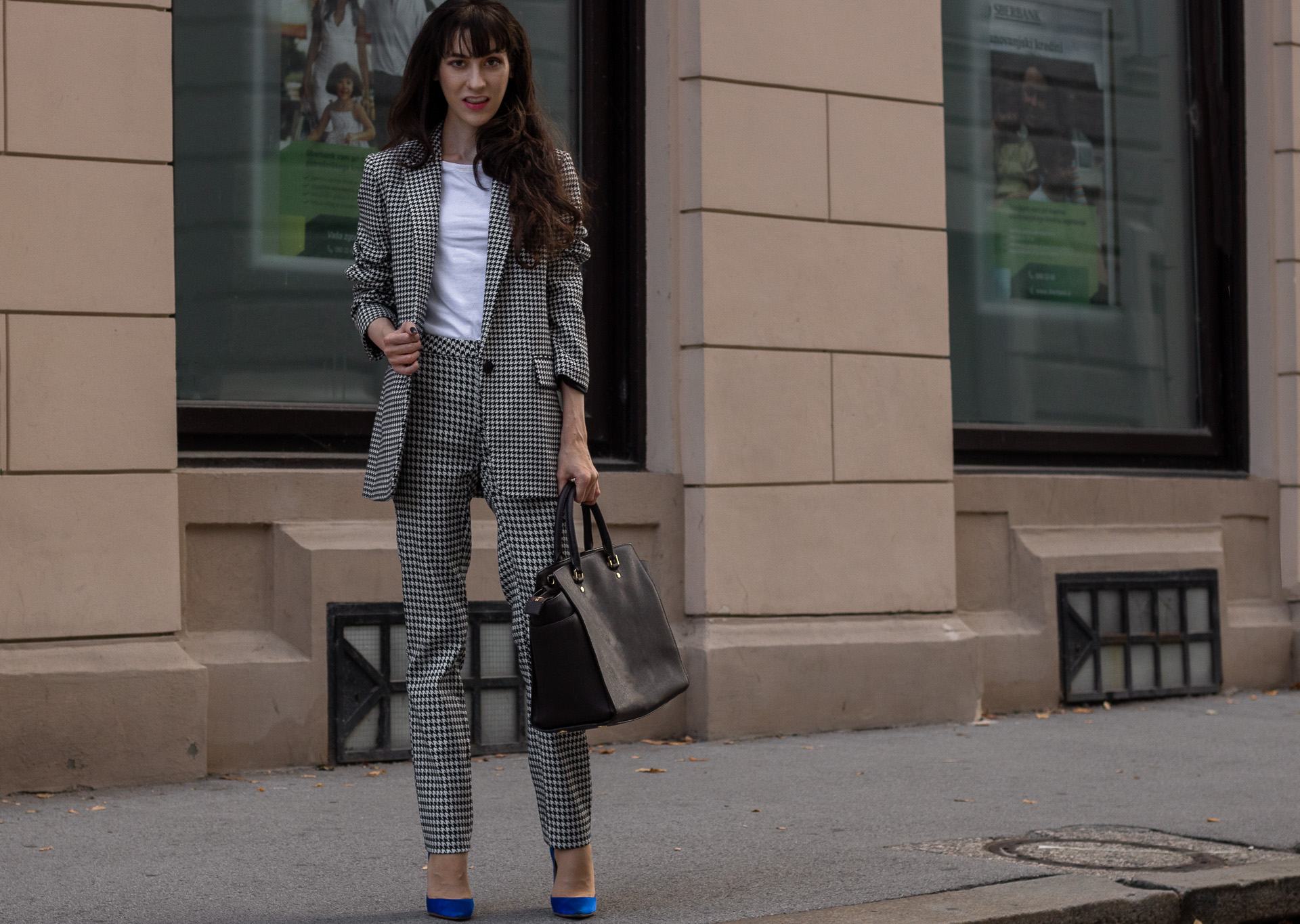 Fashion blogger Veronika Lipar of Brunette from Wall Street dressed in white Sandro houndstooth tailored blazer European Culture houndstooth pants Michael Kors Selma bag blue Gianvito Rossi pumps for office in fall
