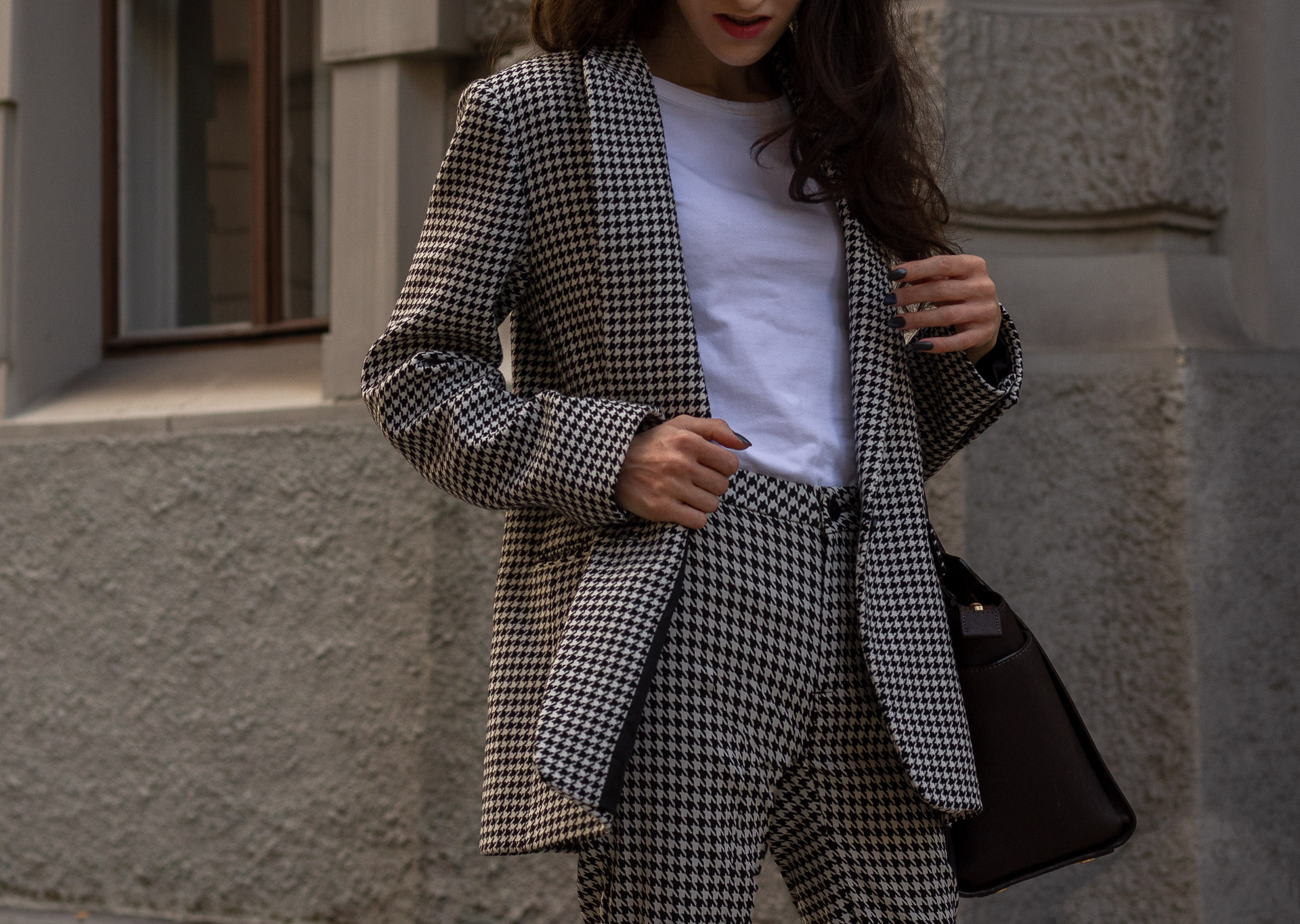 Fashion blogger Veronika Lipar of Brunette from Wall Street dressed in white Sandro houndstooth tailored blazer European Culture houndstooth pants