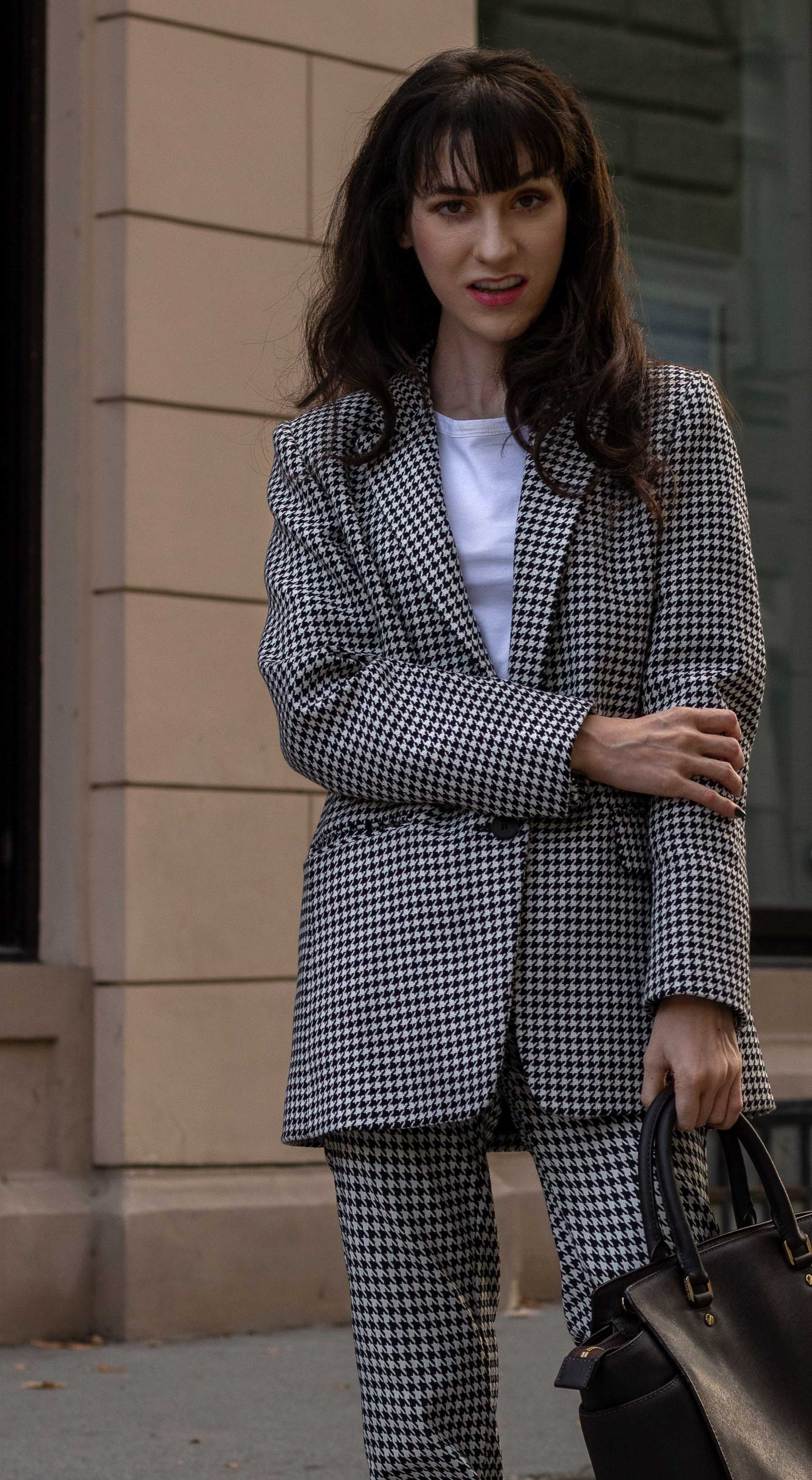 Fashion blogger Veronika Lipar of Brunette from Wall Street wearing white Sandro houndstooth tailored blazer European Culture houndstooth pants Michael Kors Selma bag