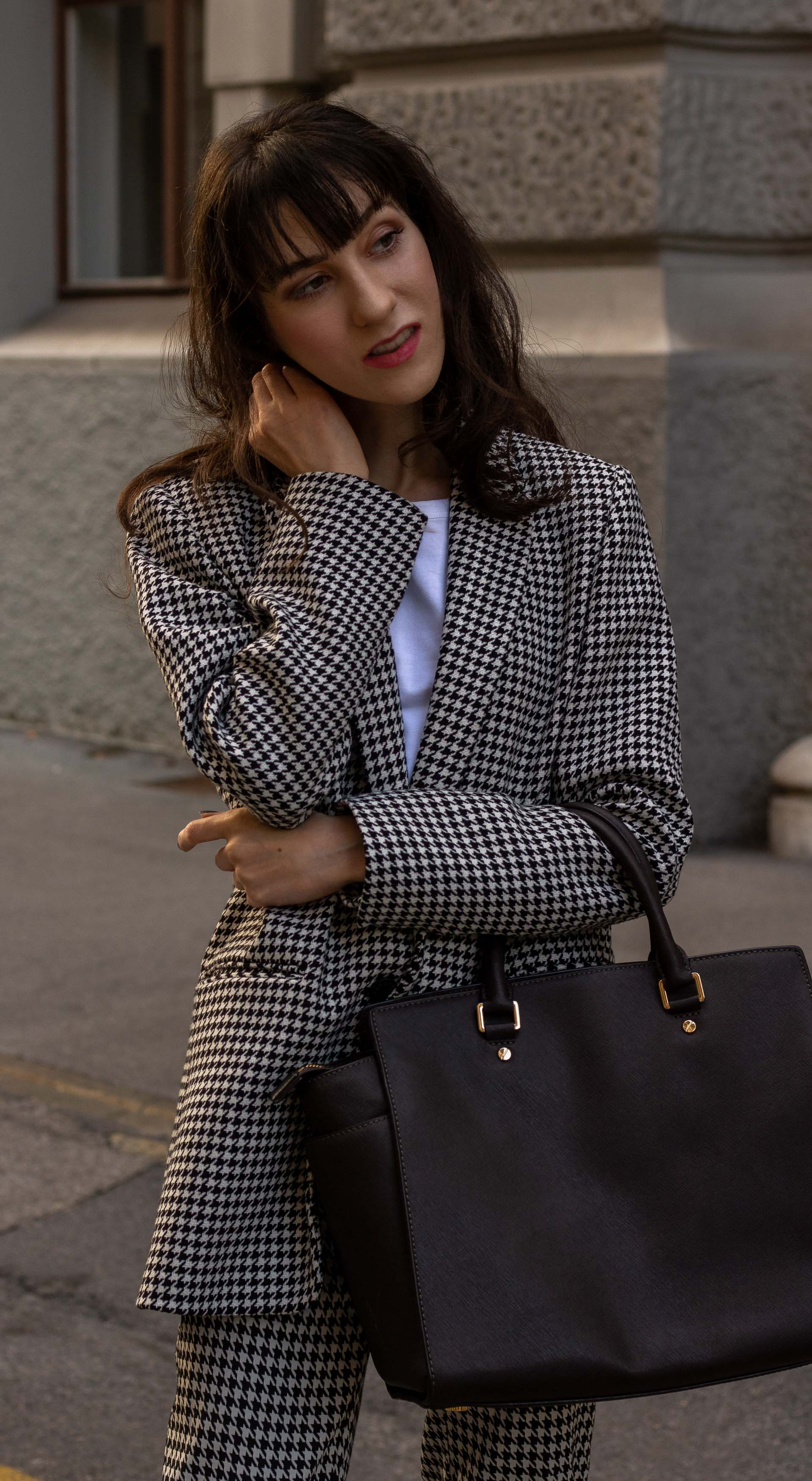 Fashion blogger Veronika Lipar of Brunette from Wall Street dressed in white Sandro houndstooth tailored blazer European Culture houndstooth pants Michael Kors Selma bag