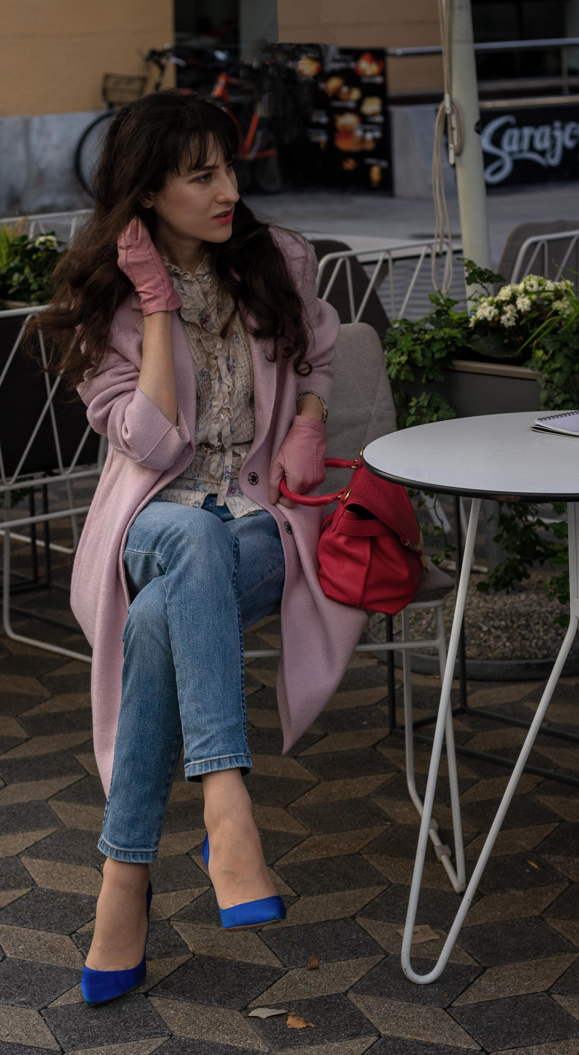 Fashion blogger Veronika Lipar of Brunette from Wall Street wearing Harris Wharf London pink coat blue A.P.C. Paris jeans floral blouse pink gloves Gianvito Rossi blue heels for brunch in fall