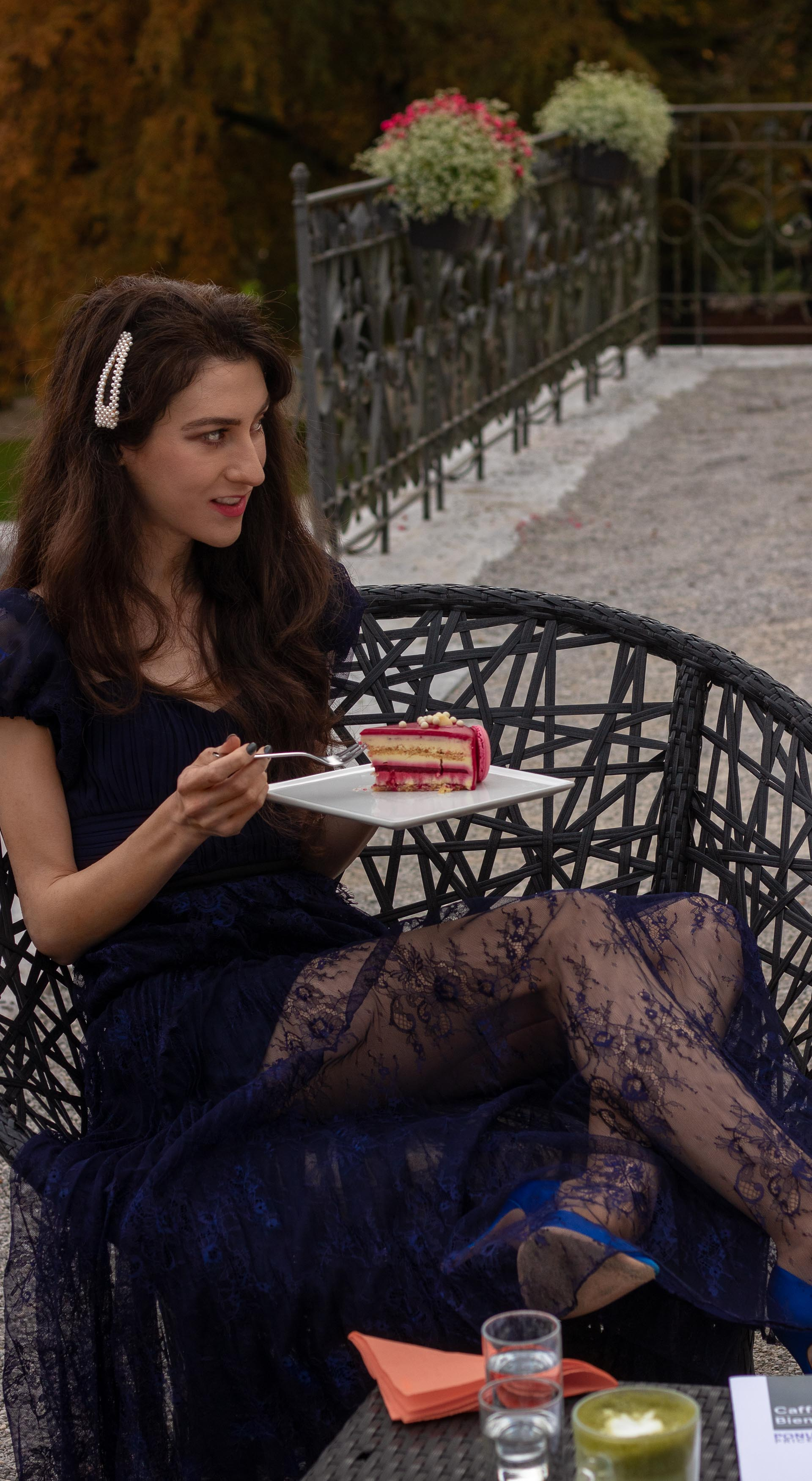 Fashion blogger Veronika Lipar of Brunette from Wall Street wearing blue Self-portrait Techno floral lace dress Blue Gianvito Rossi pumps pearl hairlip eating cake at birthday brunch party