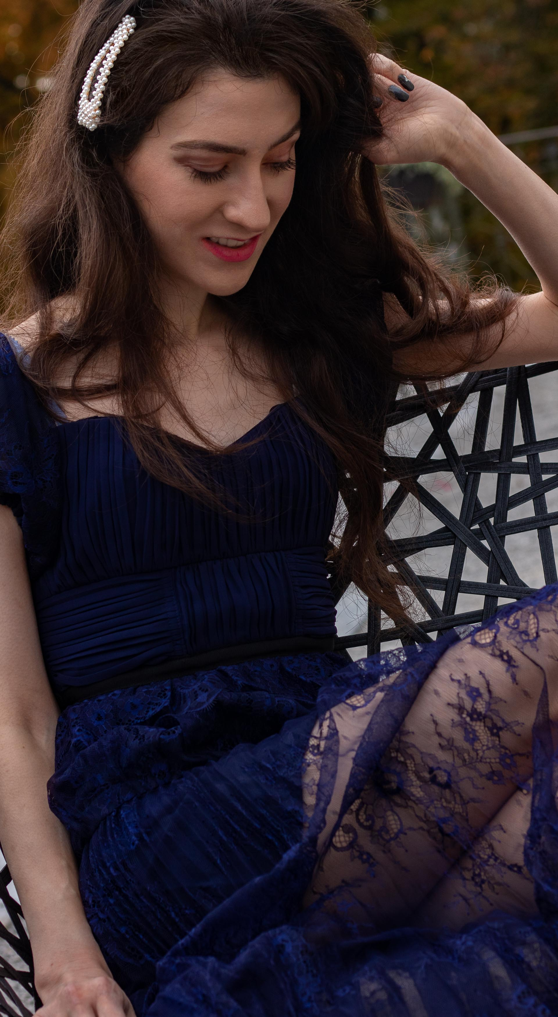 Fashion blogger Veronika Lipar of Brunette from Wall Street wearing blue Self-portrait Techno floral lace dress pearl hairclip at her birthday brunch party