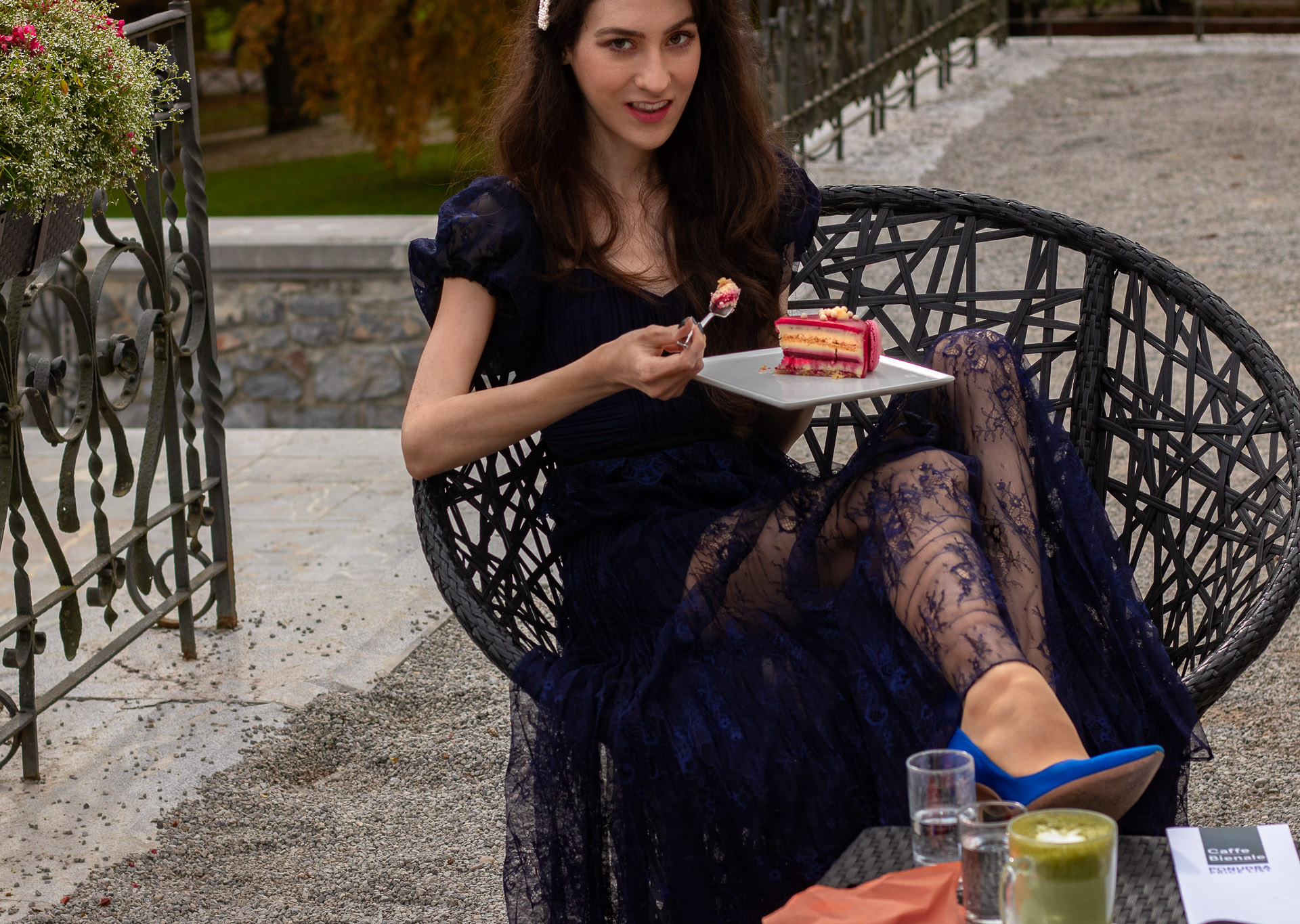 Fashion blogger Veronika Lipar of Brunette from Wall Street dressed in blue Self-portrait Techno floral lace dress Blue Gianvito Rossi pumps pearl hairlip eating cake at her birthday brunch party