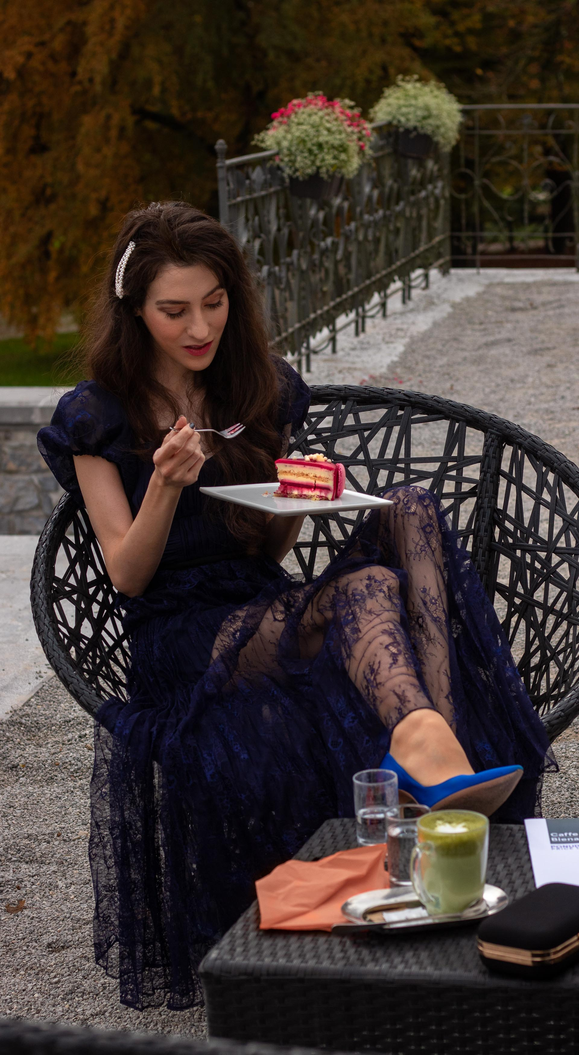 Fashion blogger Veronika Lipar of Brunette from Wall Street wearing blue Self-portrait Techno floral lace dress Blue Gianvito Rossi pumps pearl hairlip eating cake at her birthday brunch party