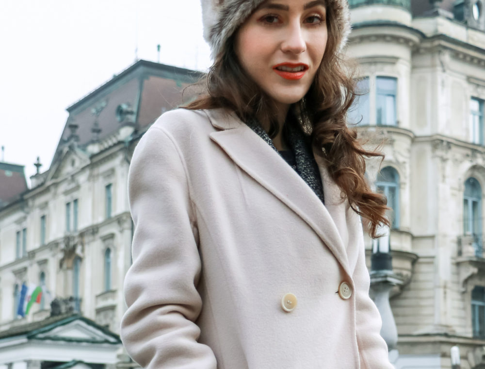 Fashion blogger Veronika Lipar of Brunette from Wall Street wearing off-white double breasted Weekend Max Mara coat faux fur hat for work in winter